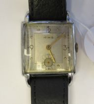 A 1947 Nimo (Girard-Perregaux) square, stainless steel cased wristwatch, faced by an Arabic dial,