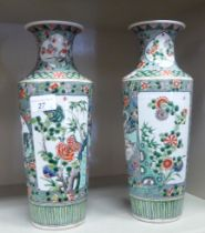A pair of late 19th/early 20thC Chinese famille verte porcelain vases of shouldered, tapered,