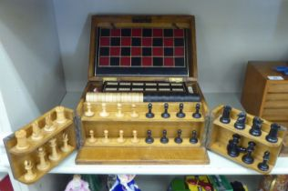 An Edwardian light oak cased tabletop games compendium: including chess, draughts,