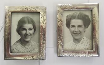 A pair of early 20thC silver coloured metal glazed photograph frames stamped Sterling 4'' x 3.