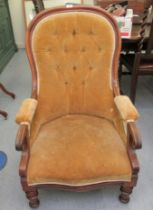 A late Victorian mahogany spoonback nursing chair, button upholstered in gold coloured fabric,