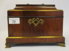 A late Regency inspired mahogany veneered and gilded tea casket of sarcophagus form with a hinged