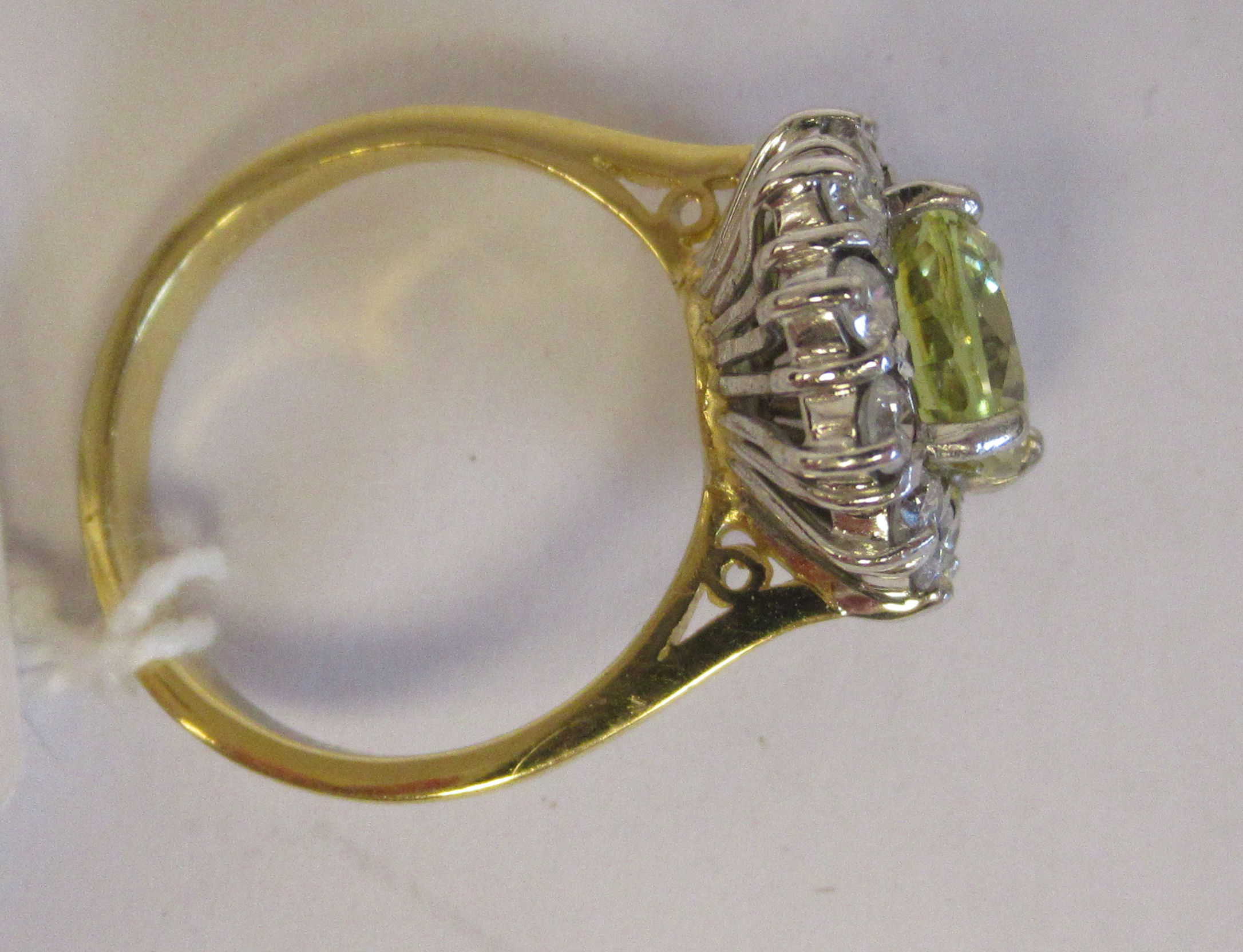 An 18ct gold cluster ring, claw set with a mild yellow Ceylon sapphire, set within a twelve stone - Image 3 of 3