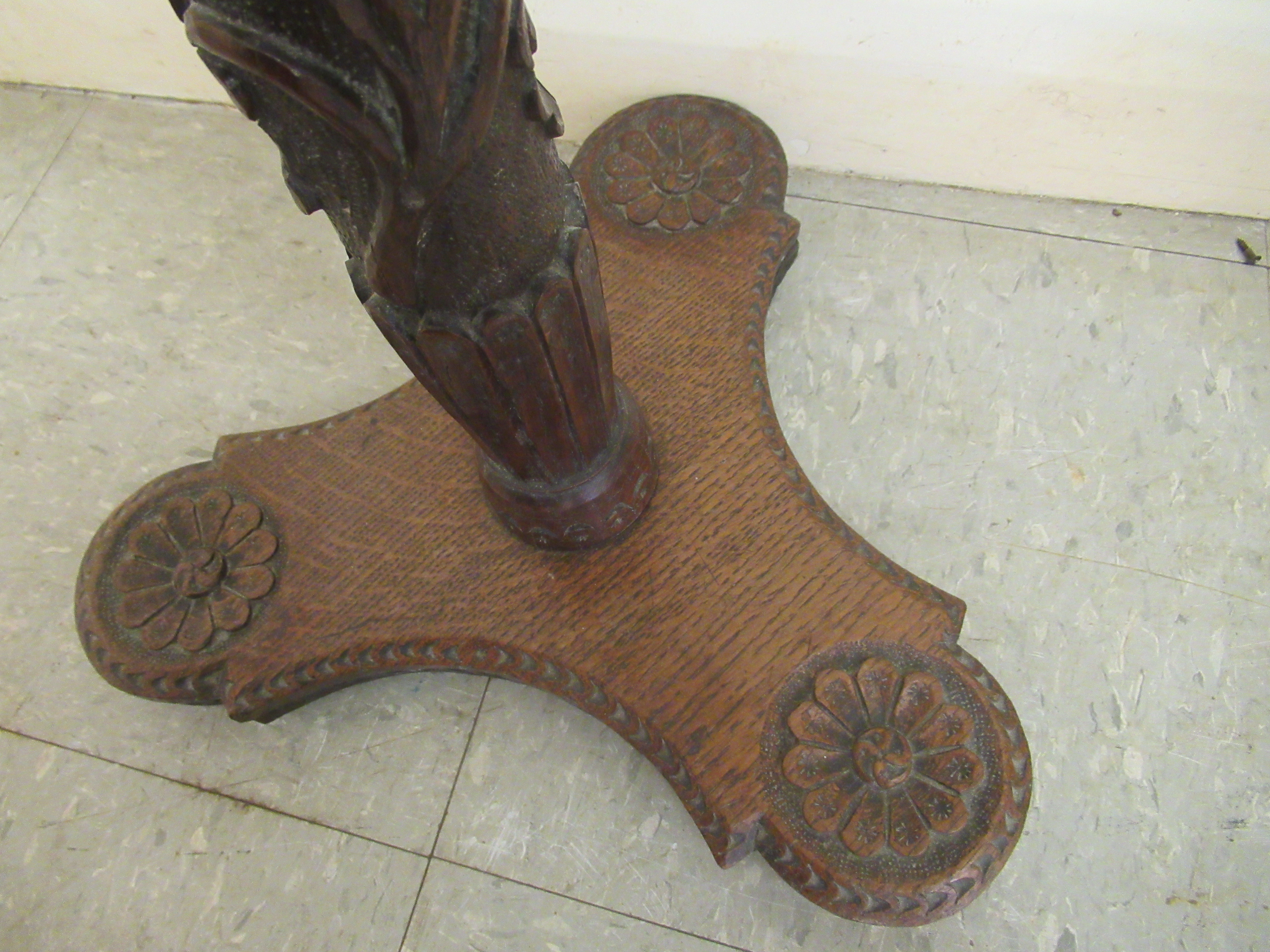 An early 19thC profusely foliate and rosette carved candlestand with a dished top and column, raised - Image 5 of 6