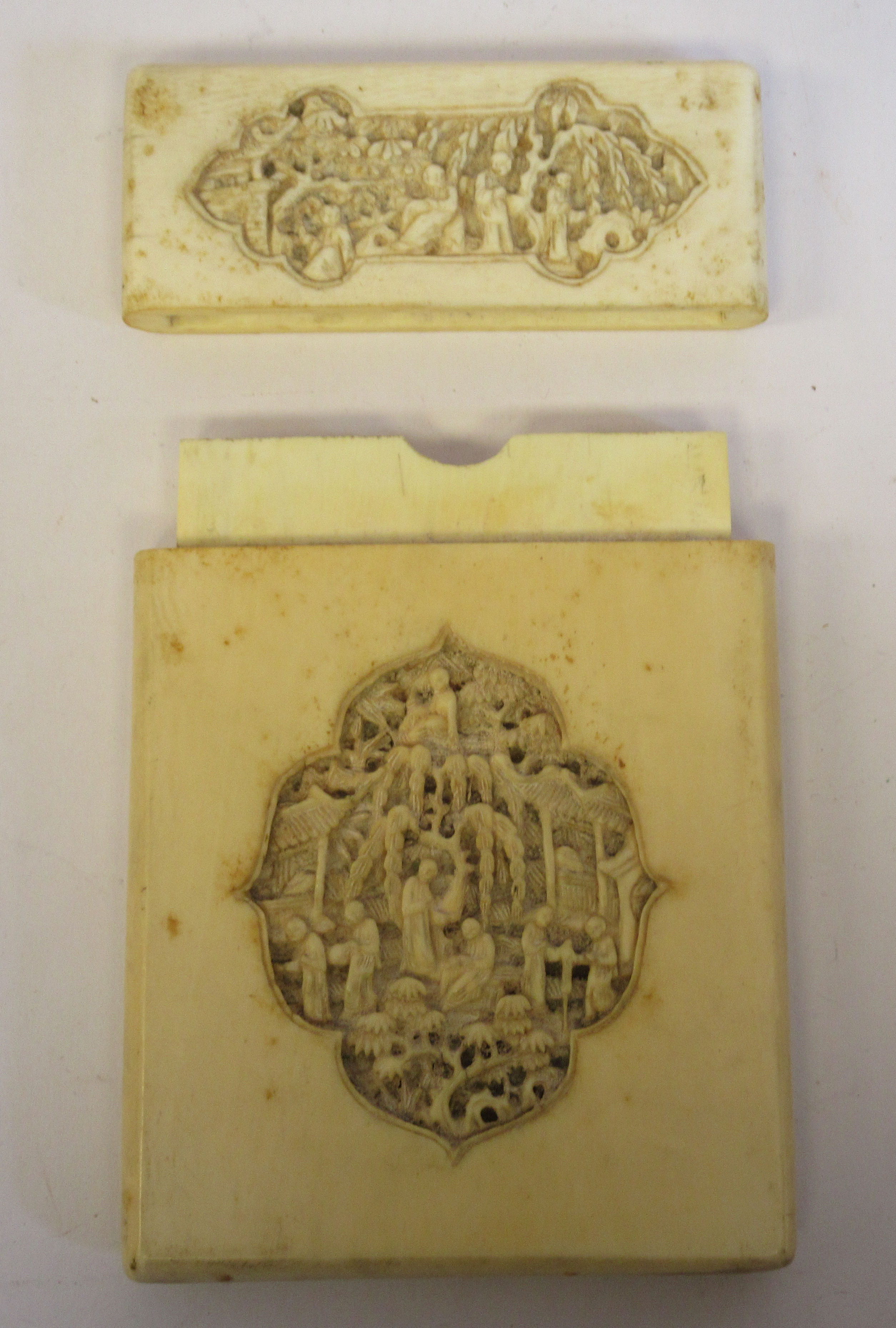 A late 19th/early 20thC Chinese ivory two part card case, carved in vignette panels with figures, in - Image 3 of 5