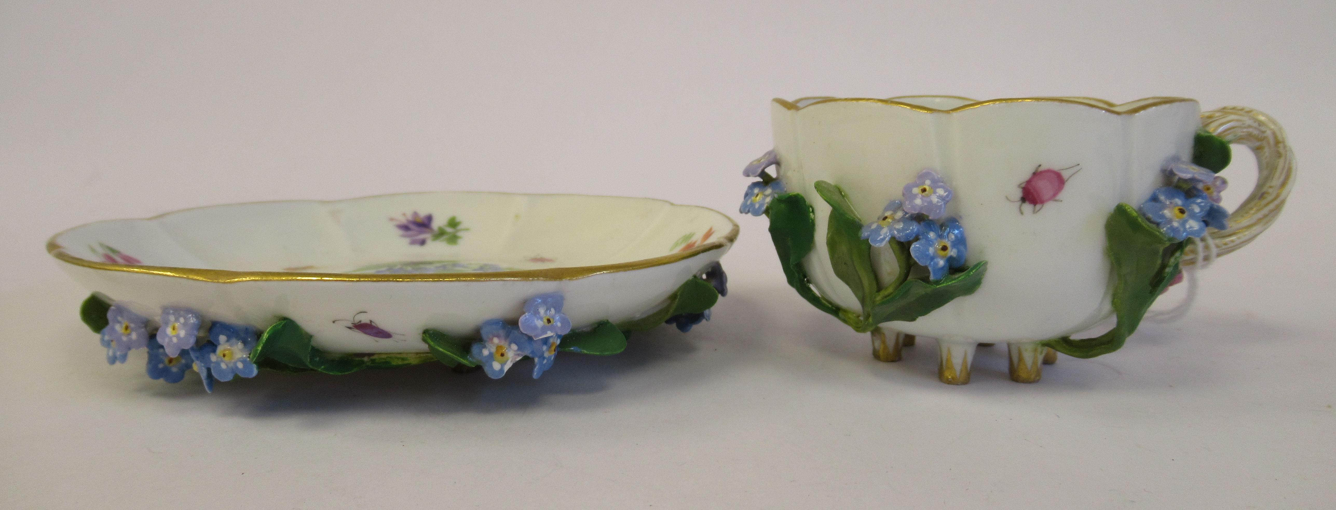 A 19thC Meissen porcelain cup and saucer, having an entwined twig handle, decorated with encrusted - Image 3 of 10