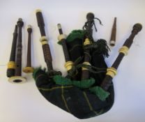 A set of vintage hardwood and ivory mounted bagpipes, the chanter stamped DnMcDougall,
