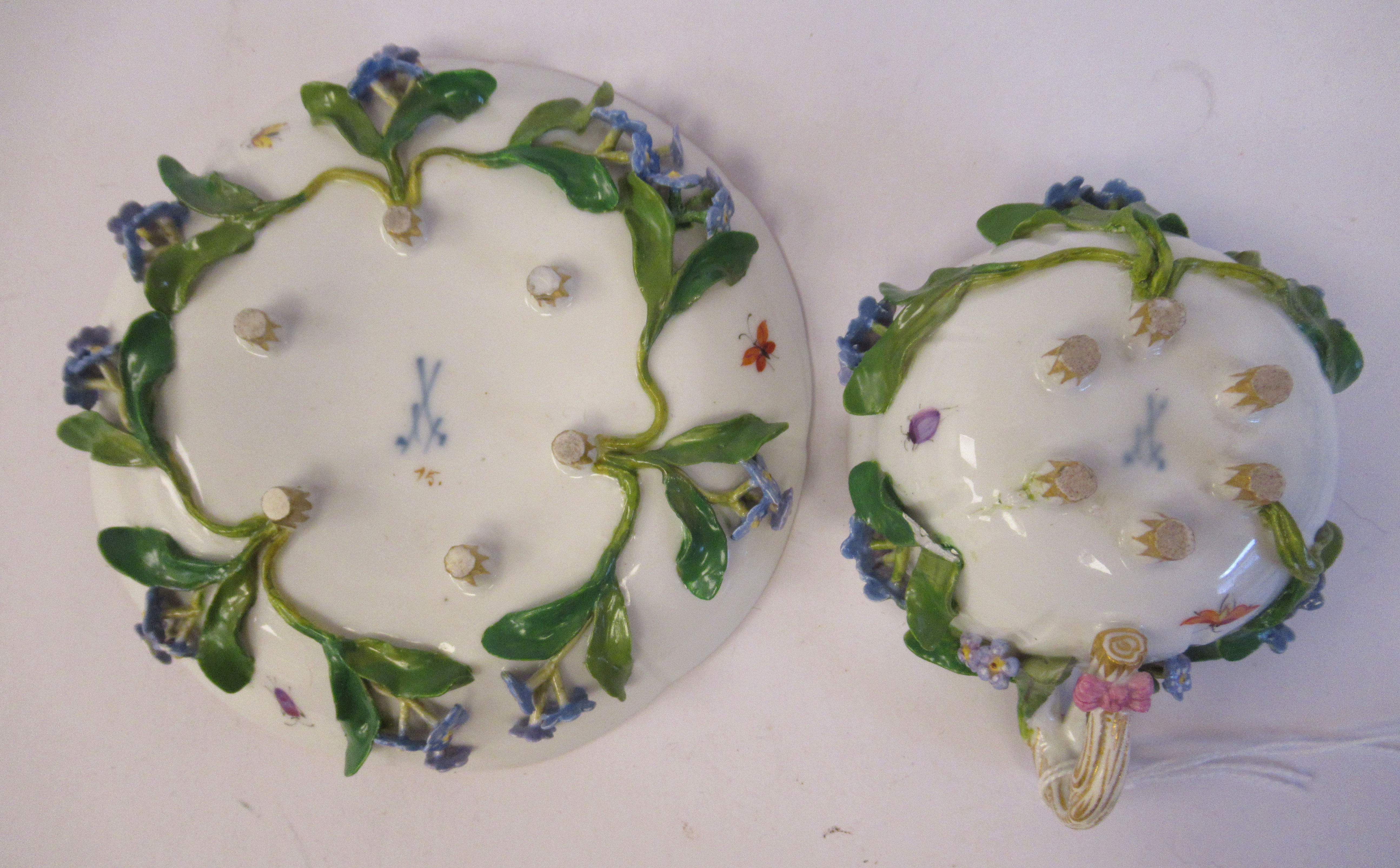 A 19thC Meissen porcelain cup and saucer, having an entwined twig handle, decorated with encrusted - Image 6 of 10