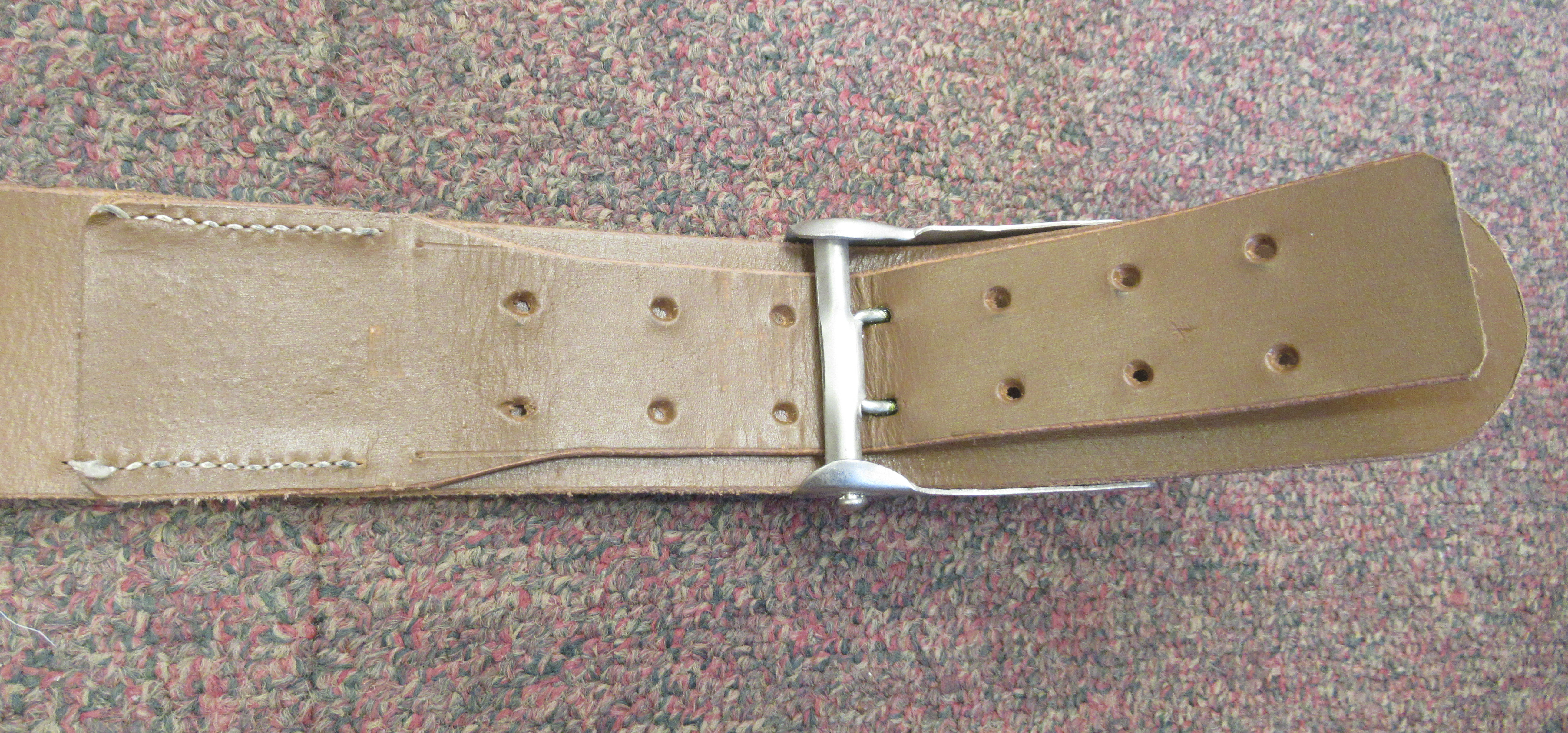 A Third Reich Luftwaffe black hide belt with an impressed weathered spreadeagle emblem, on the white - Image 4 of 5