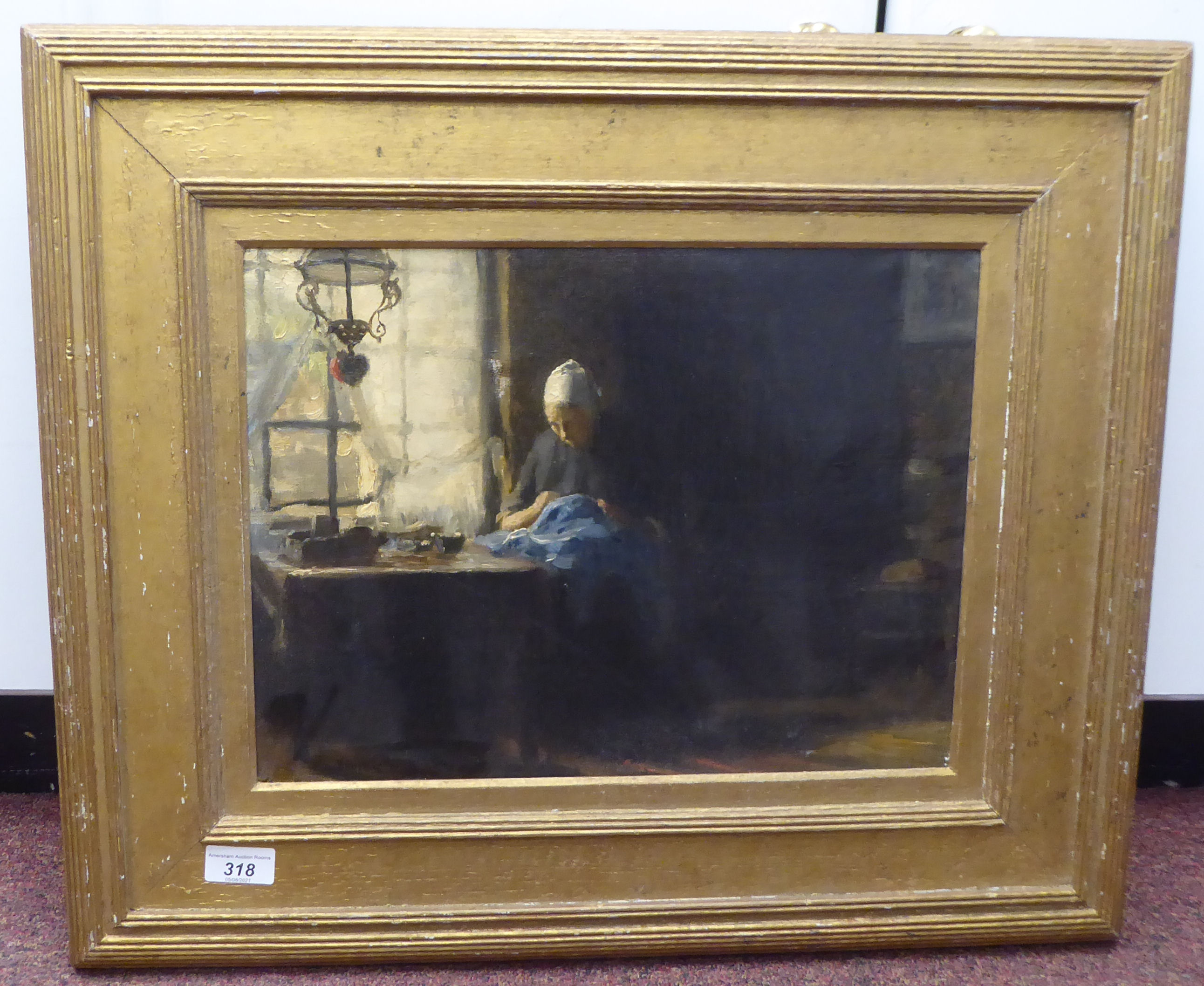 William Norton - a Dutch interior scene, depicting a woman doing needlework, seated at a table by