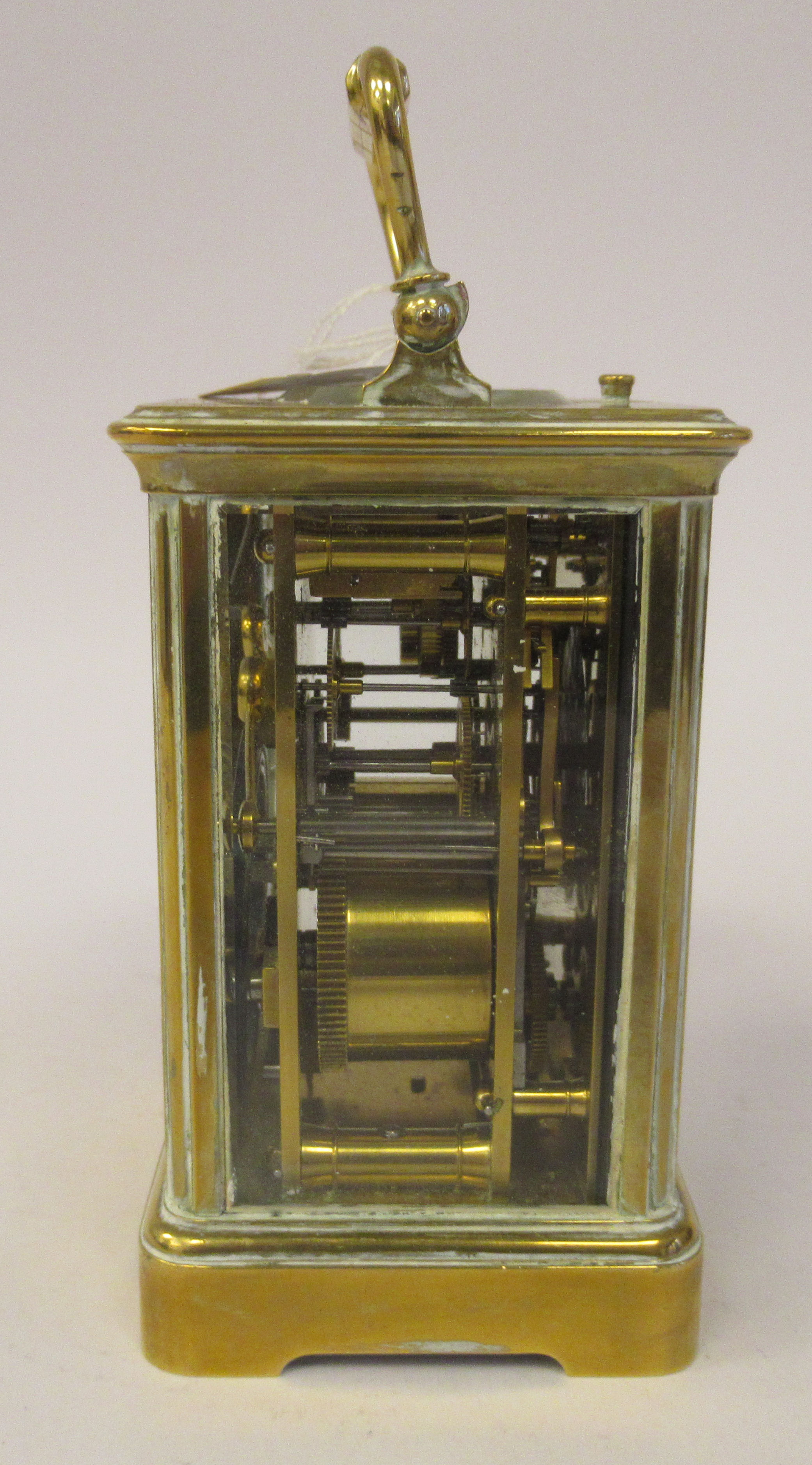 An early 20thC brass cased carriage clock with bevelled glass panels, a folding top handle, on a - Image 5 of 9