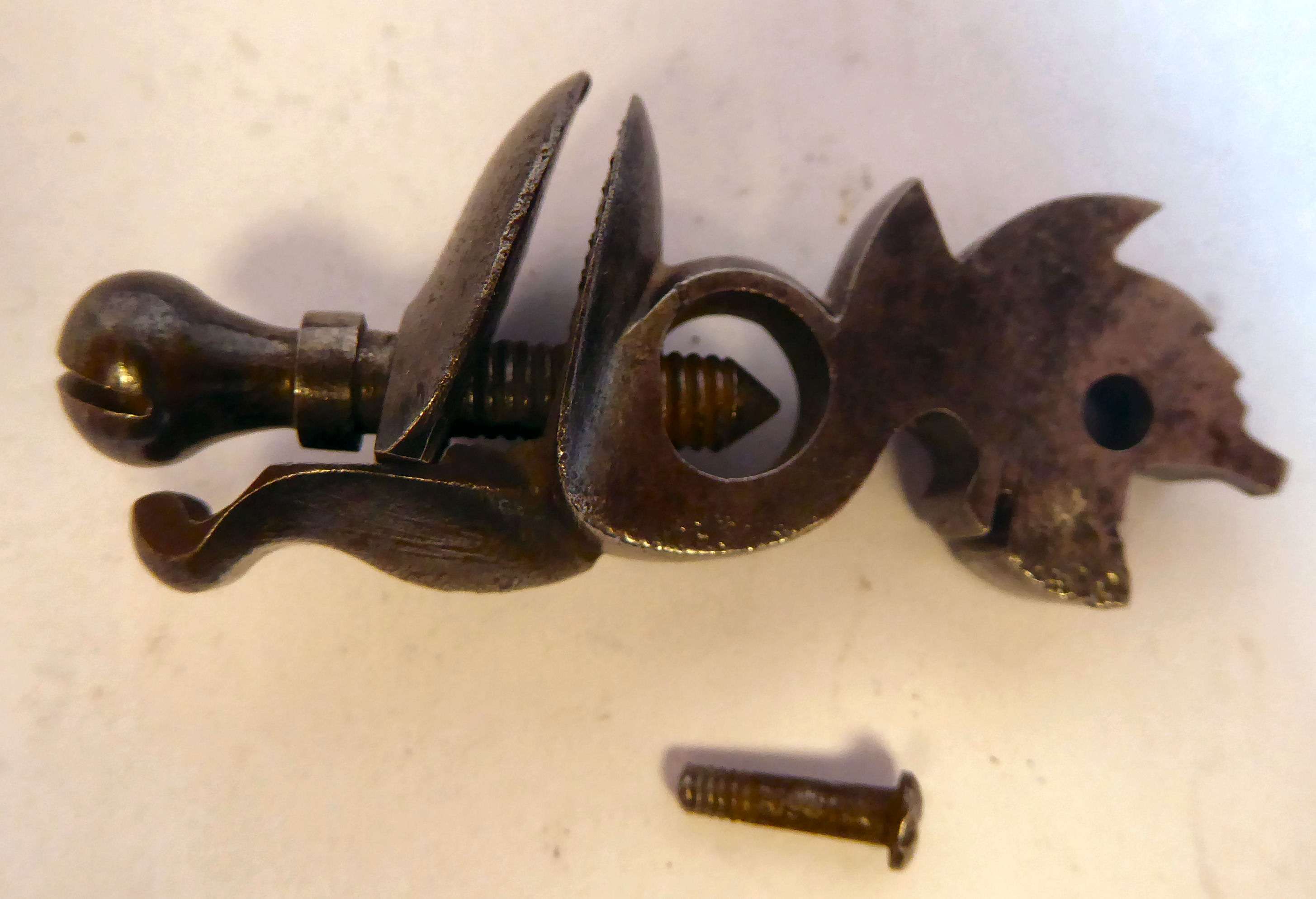 A 19thC Continental flintlock pistol with a folding trigger, inlaid wire ornament on the walnut - Image 3 of 9