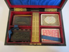 A late Victorian coromandel veneered games compendium, the shallow box enclosed by a lockable hinged