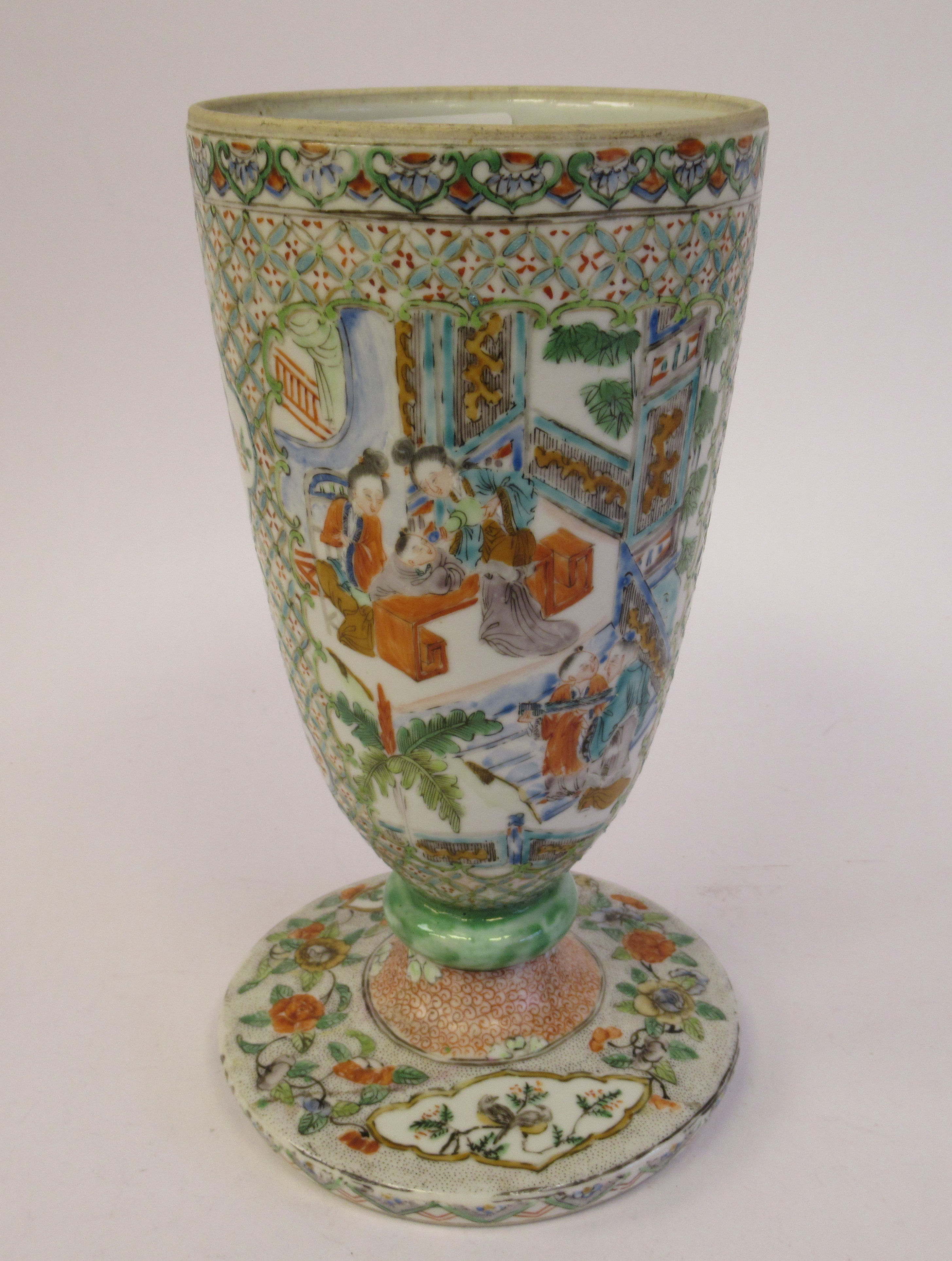 A late 19thC Chinese porcelain trumpet shaped vase, decorated with figures in relief, on a splayed