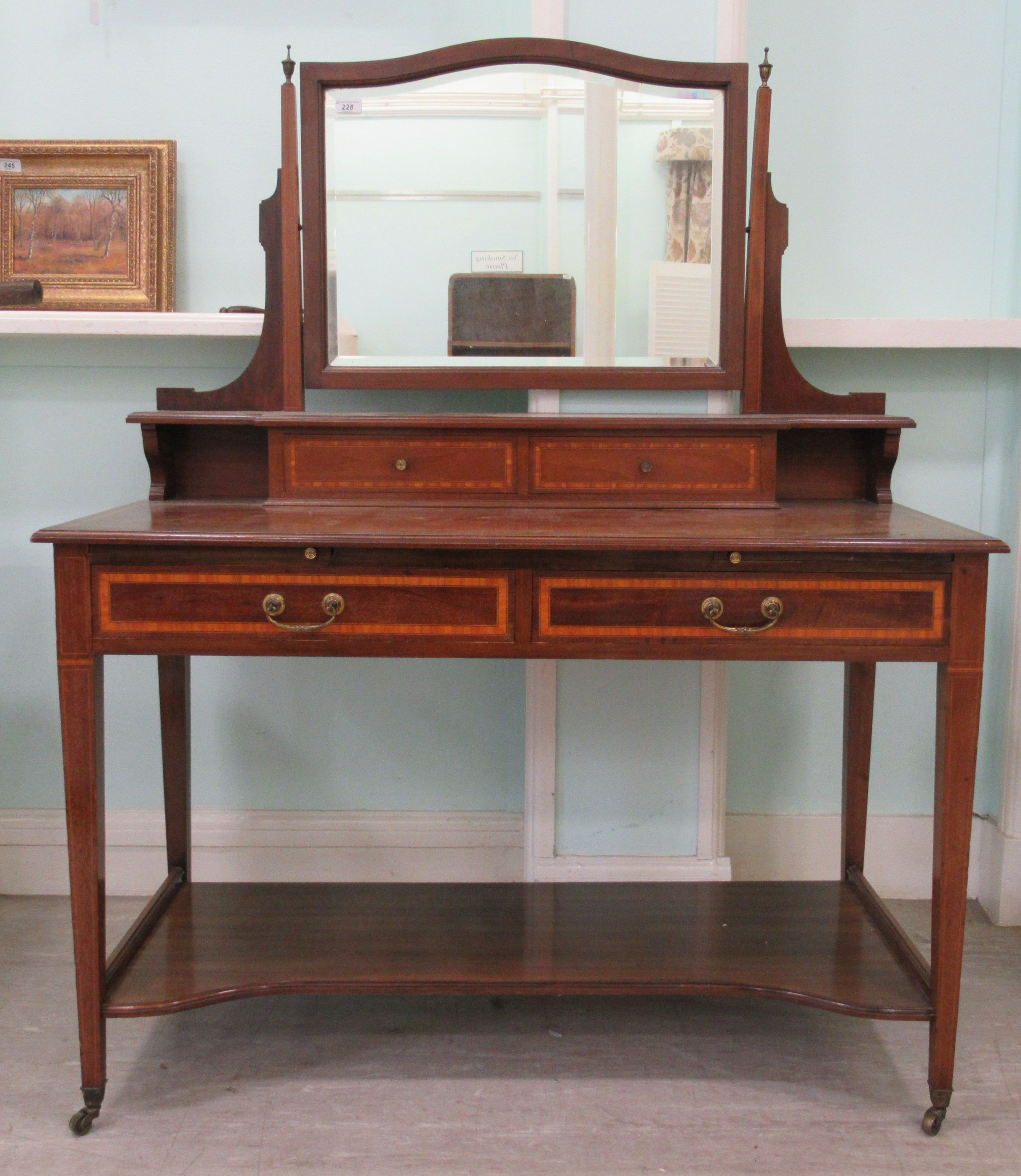 An Edwardian Maple & Co string inlaid ebony and crossbanded mahogany dressing table, surmounted by a