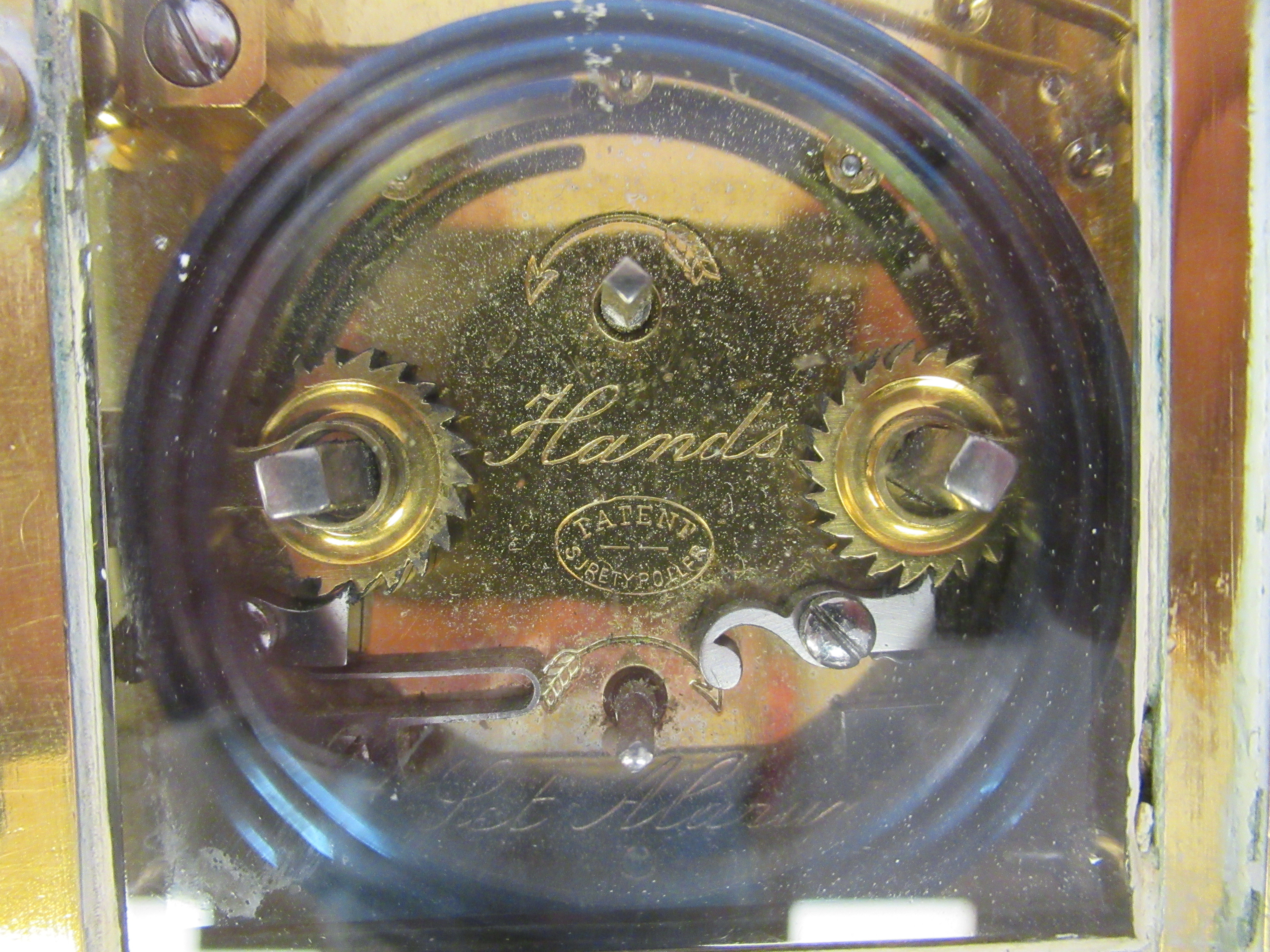 An early 20thC brass cased carriage clock with bevelled glass panels, a folding top handle, on a - Image 8 of 9
