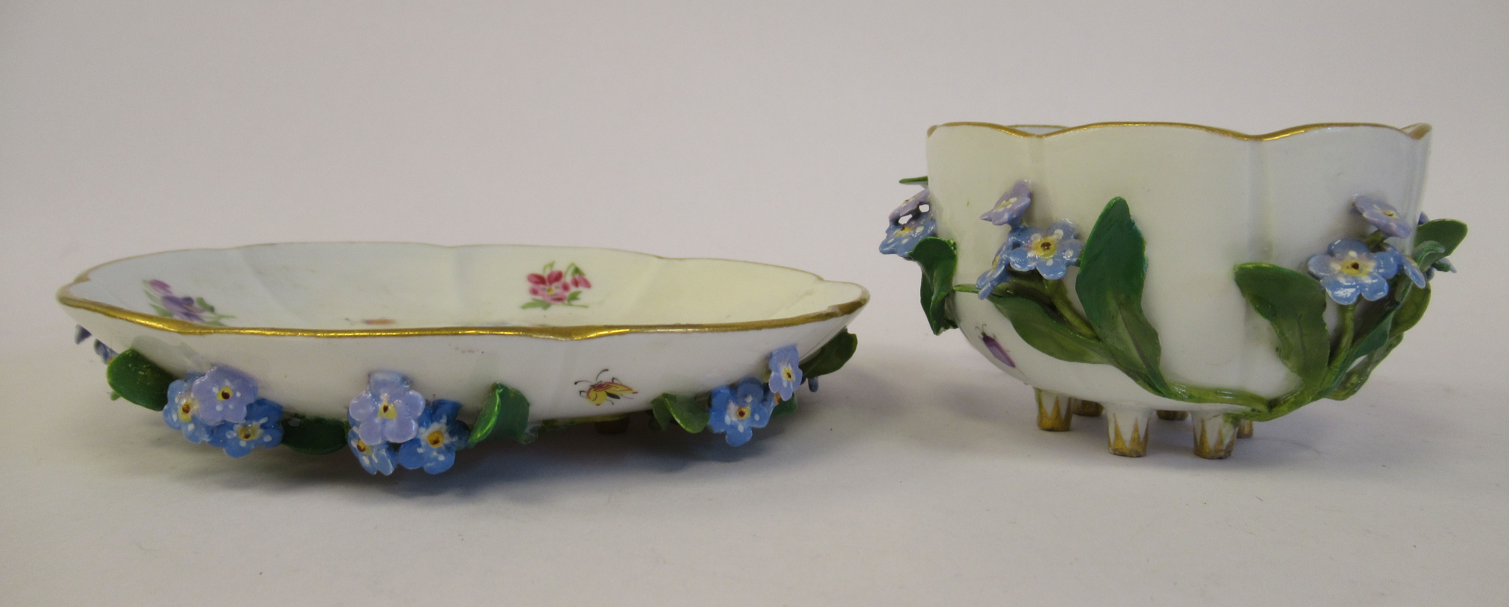 A 19thC Meissen porcelain cup and saucer, having an entwined twig handle, decorated with encrusted - Image 4 of 10
