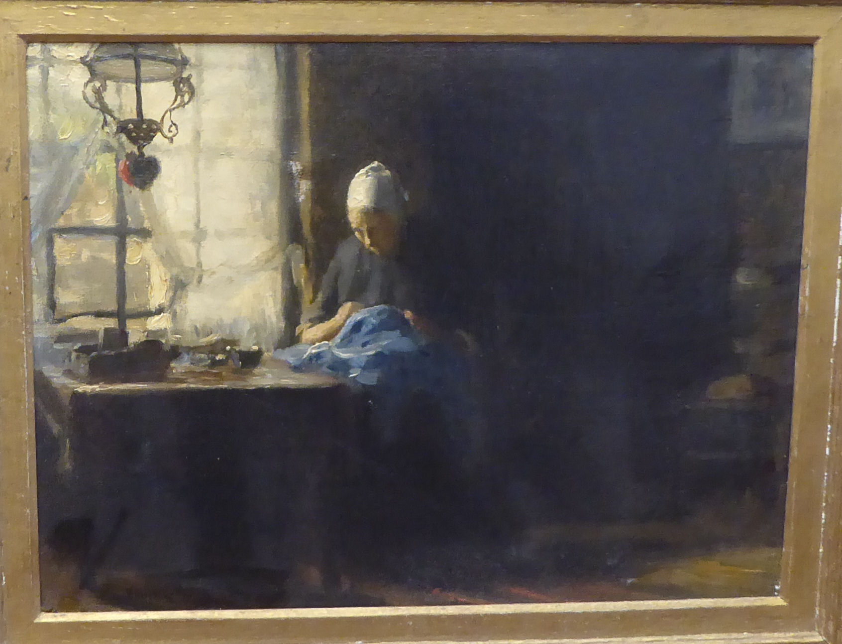 William Norton - a Dutch interior scene, depicting a woman doing needlework, seated at a table by - Image 2 of 5