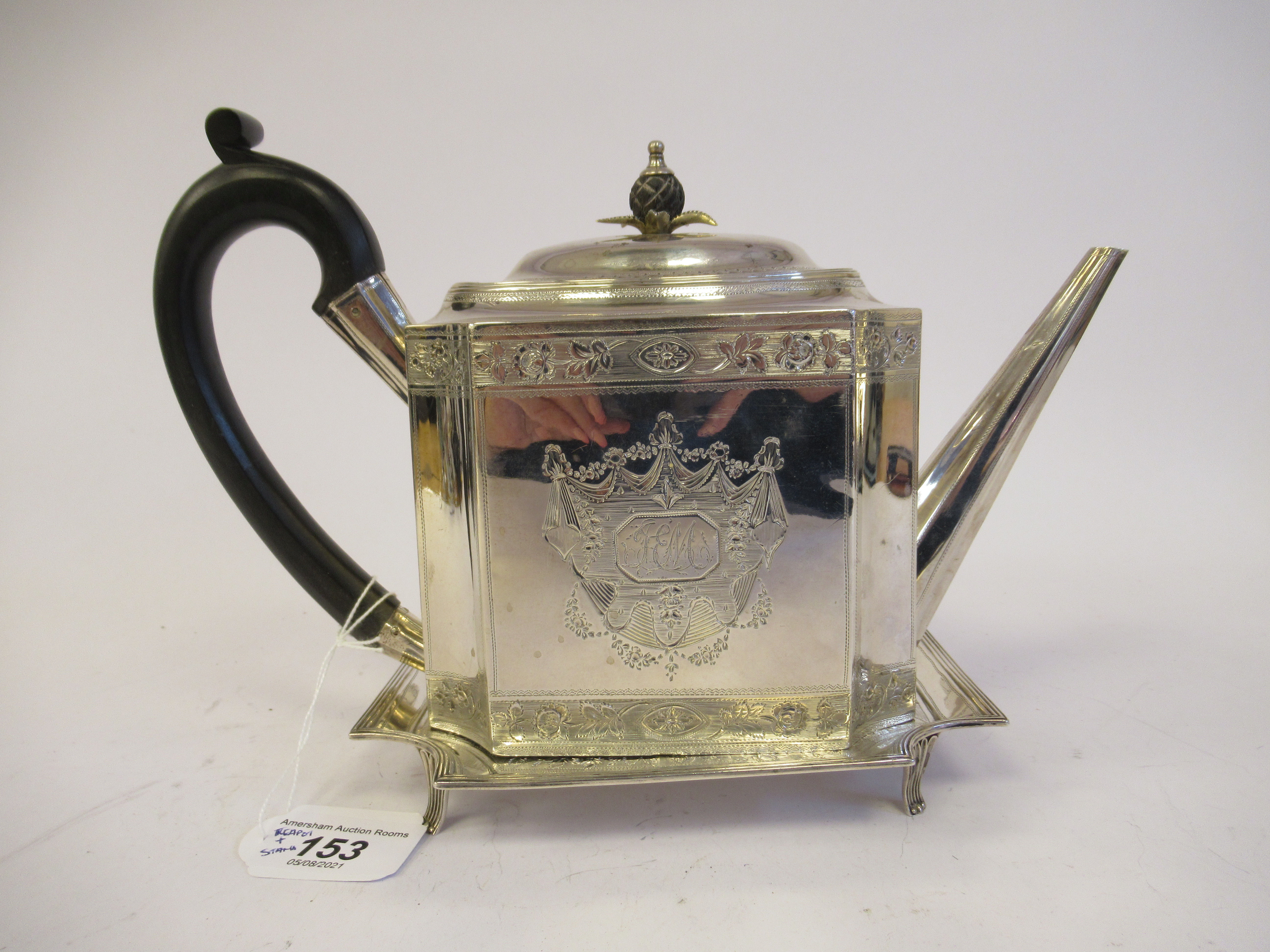 A George III silver teapot of straight sided, incurved box design, having an angled straight,