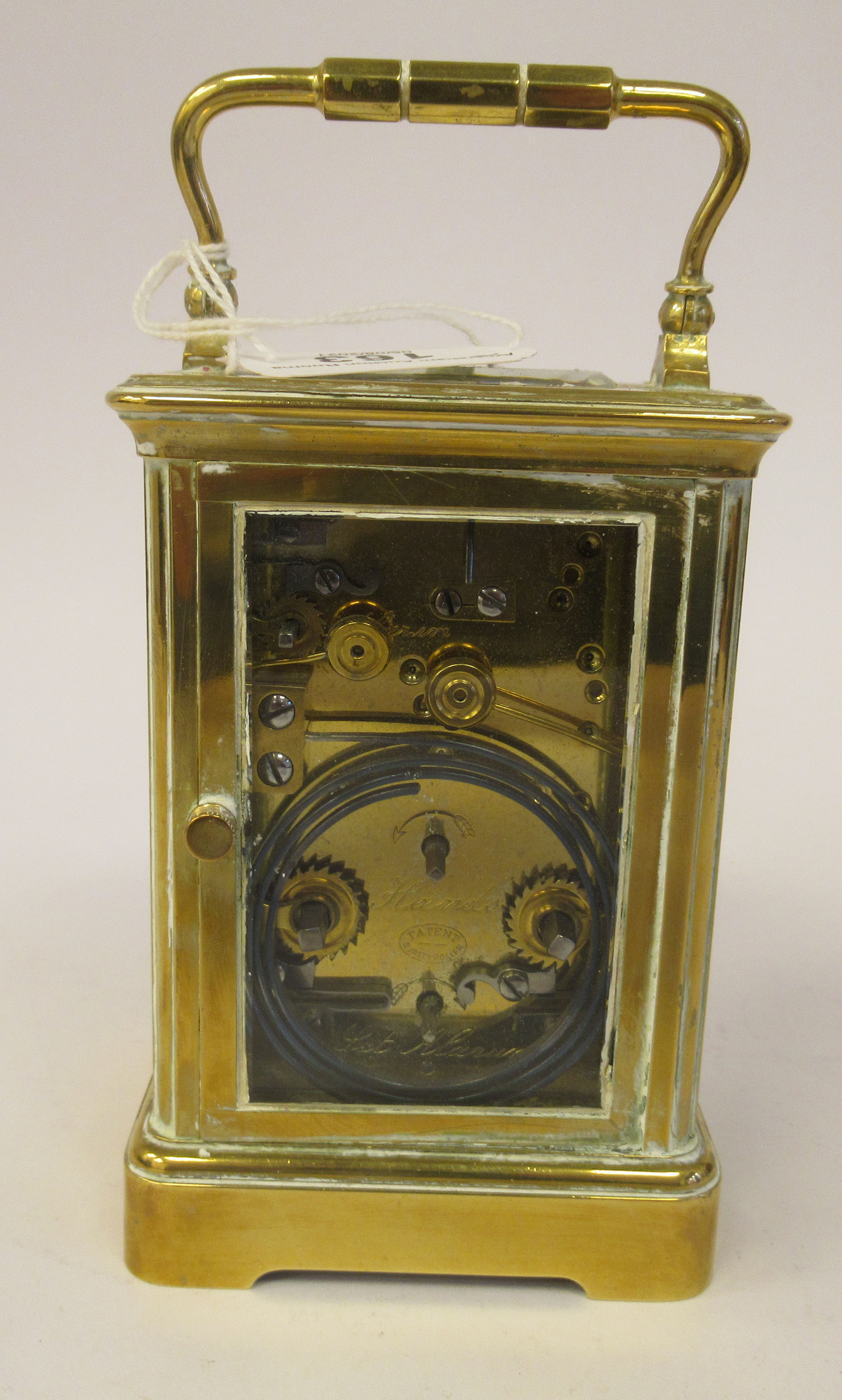 An early 20thC brass cased carriage clock with bevelled glass panels, a folding top handle, on a - Image 4 of 9