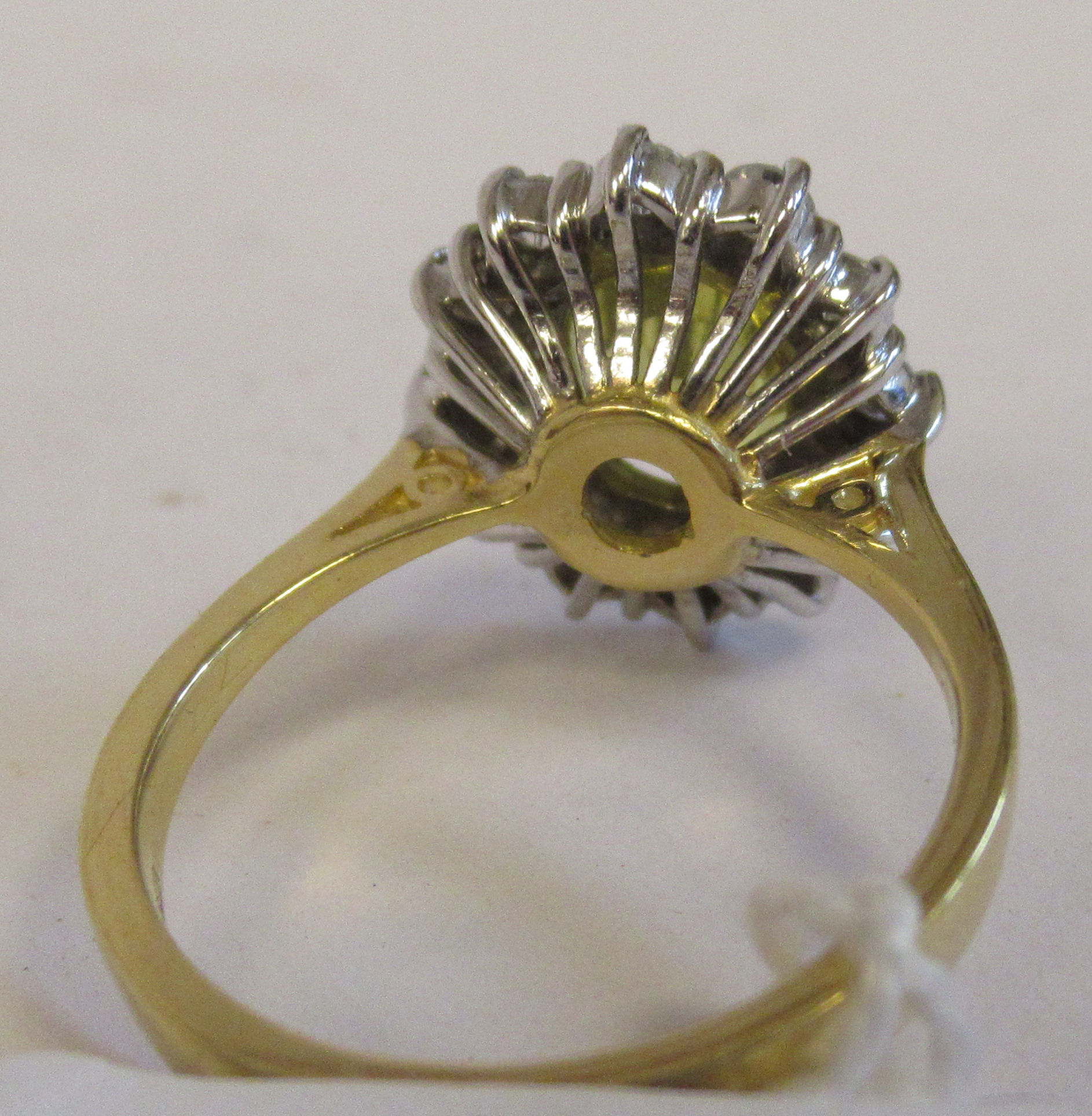 An 18ct gold cluster ring, claw set with a mild yellow Ceylon sapphire, set within a twelve stone - Image 2 of 3