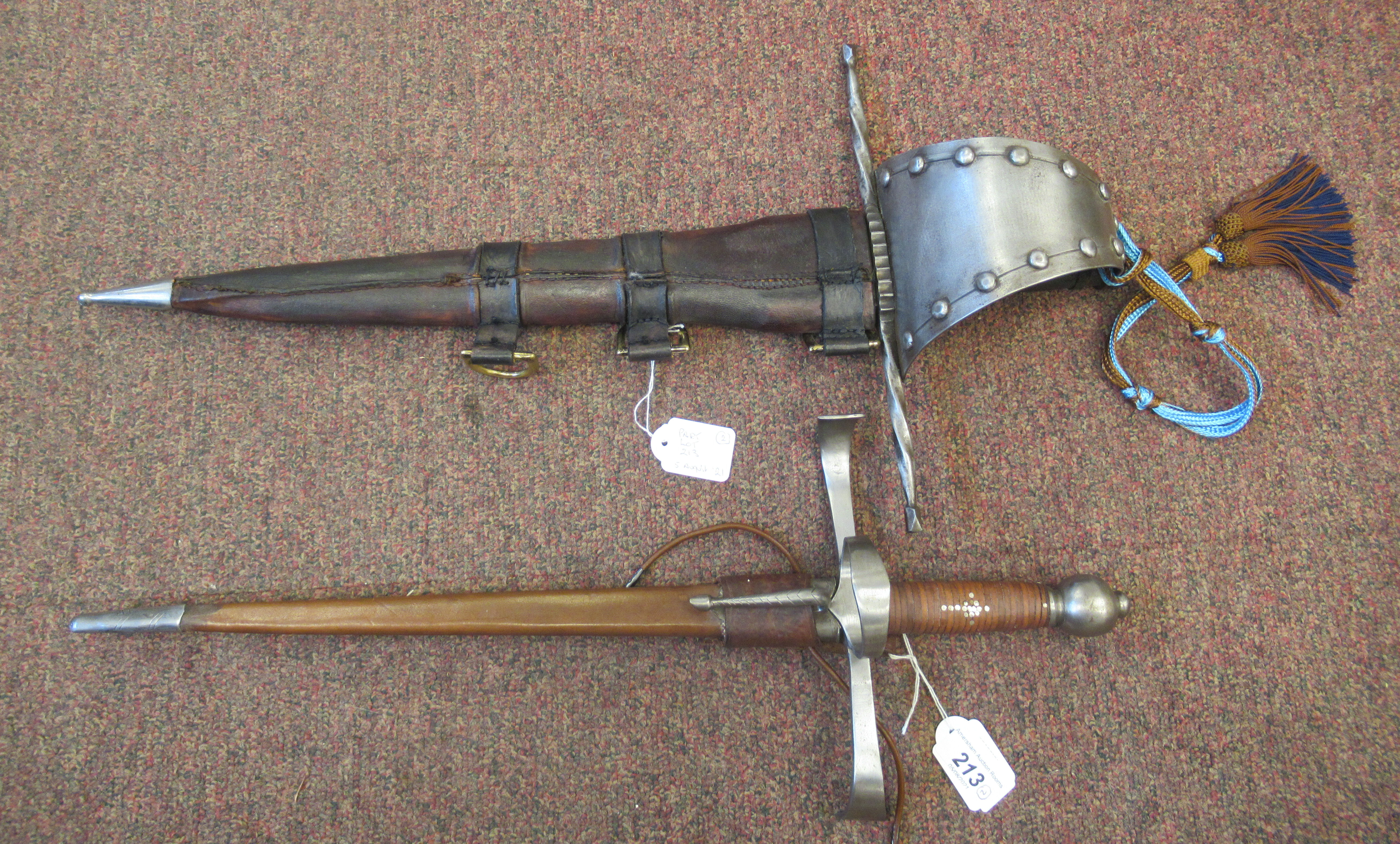 """A replica Medieval short sword with a hide bound handle, wide hilt and blade 13.5""""L in a stitched"""