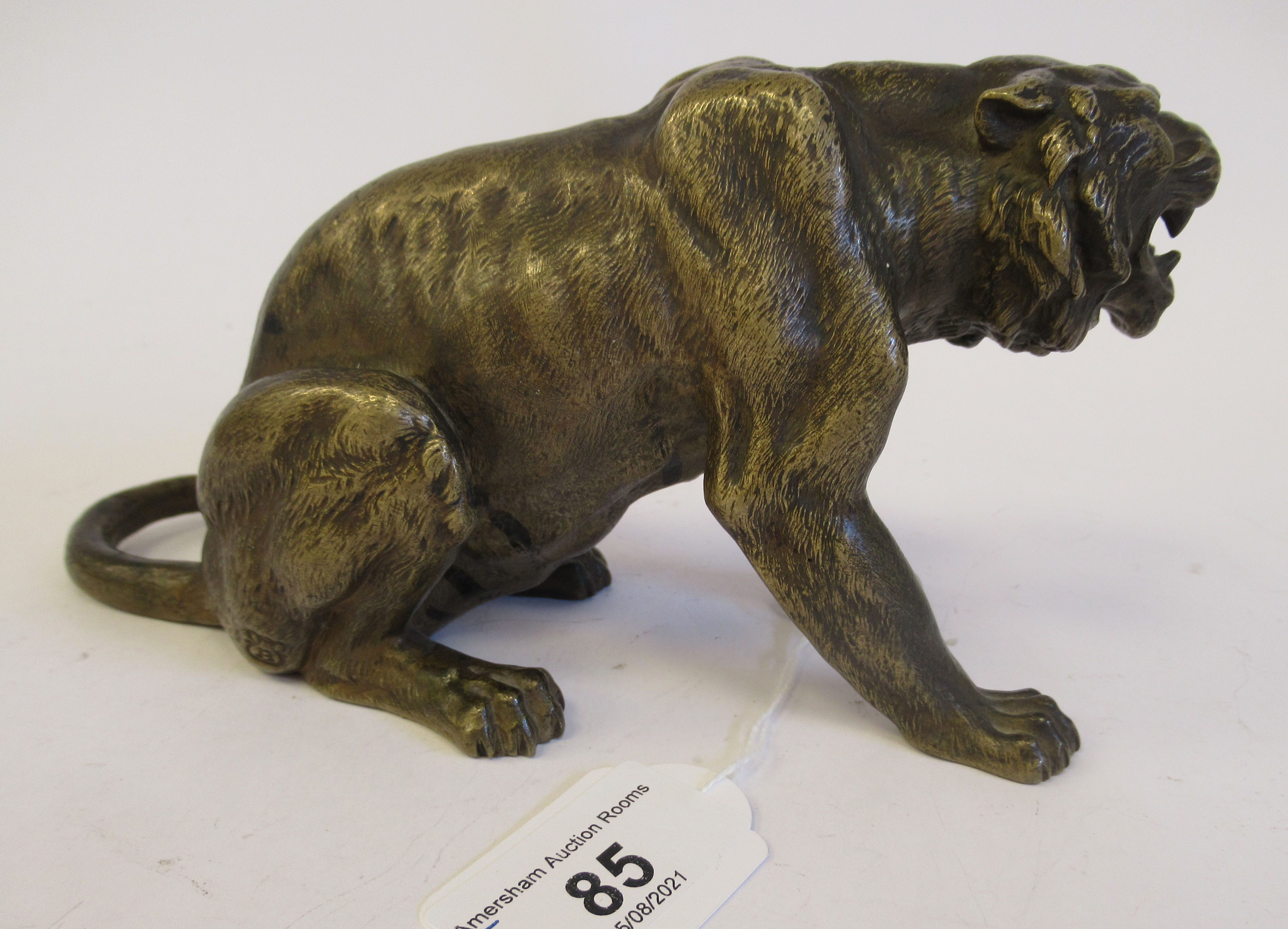 An Austrian cold cast bronze model, a seated, snarling big cat bears traces of paint & an - Image 3 of 8
