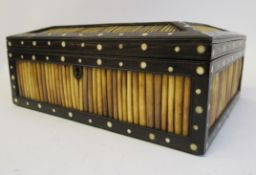 A late 19th/early 20thC Anglo-Indian hardwood and cut porcupine quill casket, decorated with