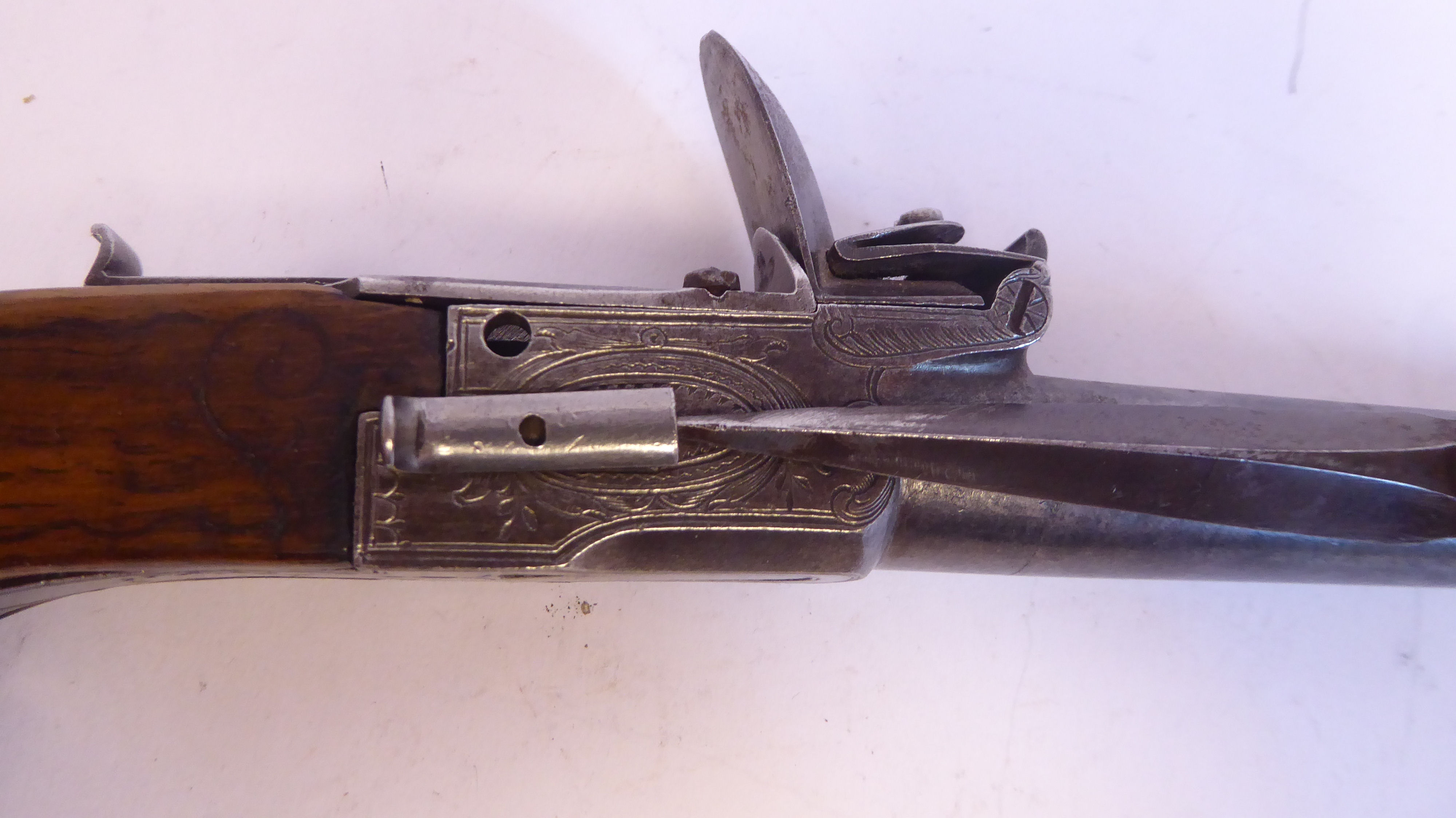 A 19thC Continental flintlock pistol with a folding trigger, inlaid wire ornament on the walnut - Image 4 of 9
