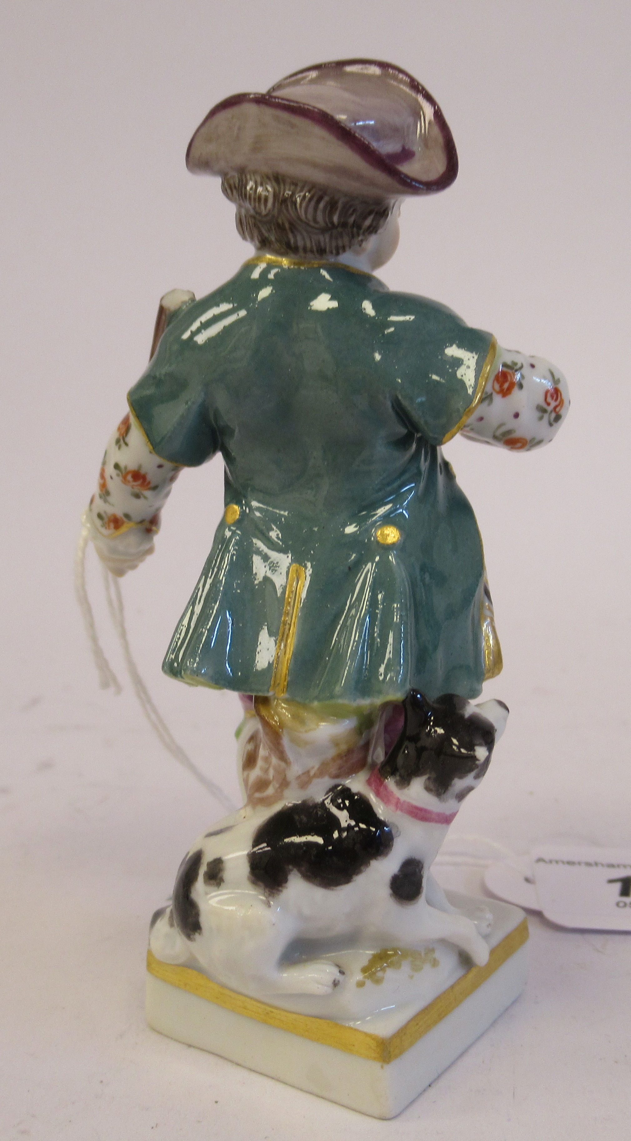 A 19th/20thC Meissen porcelain figure, a boy wearing a frock coat with a dog at his side, on a - Image 2 of 4