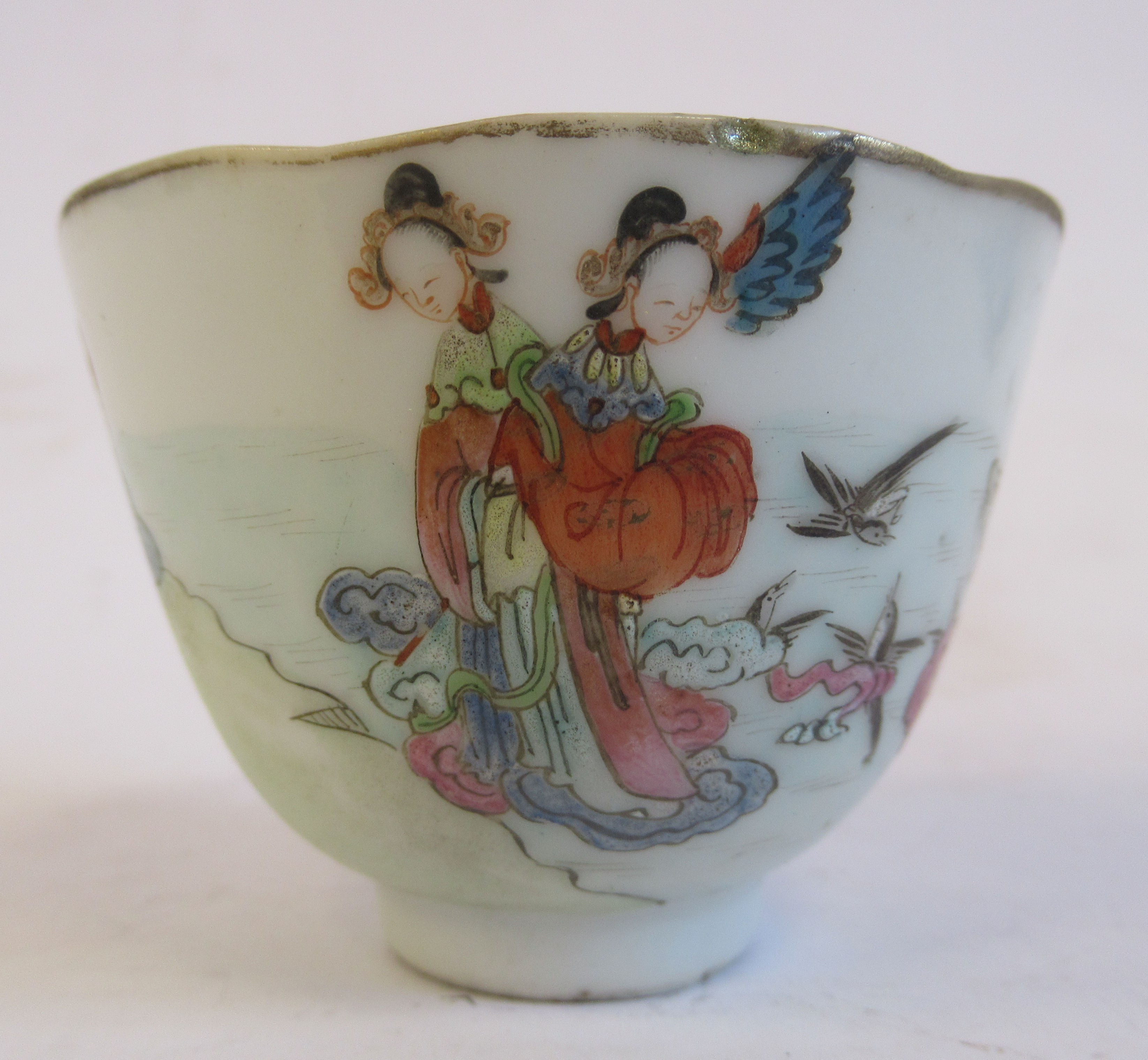 """A 19thC Chinese porcelain footed wine cup, decorated in famille rose with figures and birds 1.75""""h"""