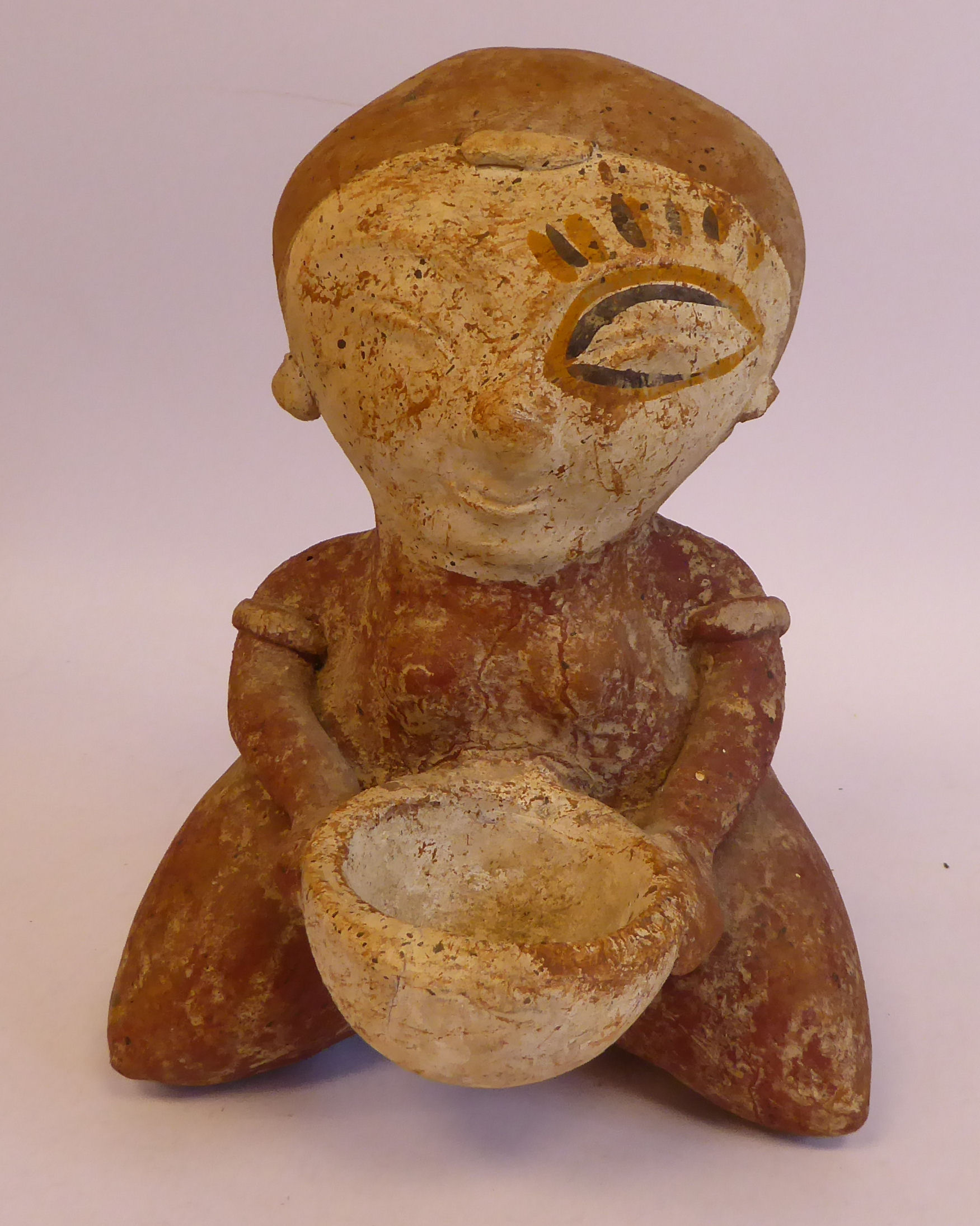 """An African painted pottery tribal figure, a kneeling woman, holding a bowl 10""""h"""