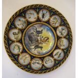 A late 19th/early 20thC faience, tin glazed pottery dish with a recessed centre and wide rim,
