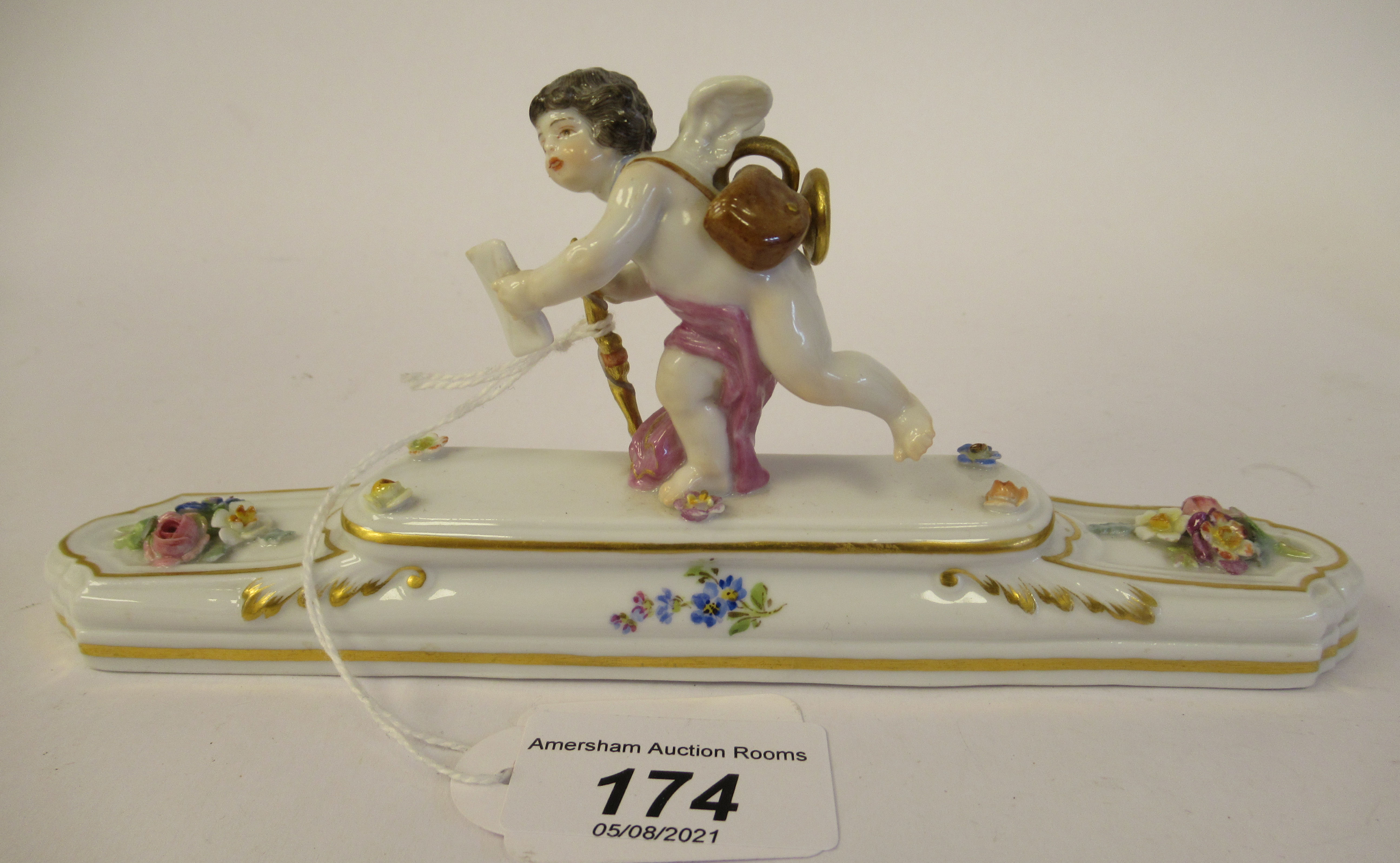A 20thC Meissen gilded porcelain paperweight, featuring a standing cherubic figure with a staff,