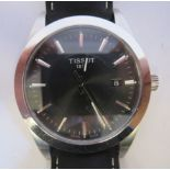 A Tissot 1853 stainless steel cased wristwatch, the movement with sweeping seconds, faced by a black