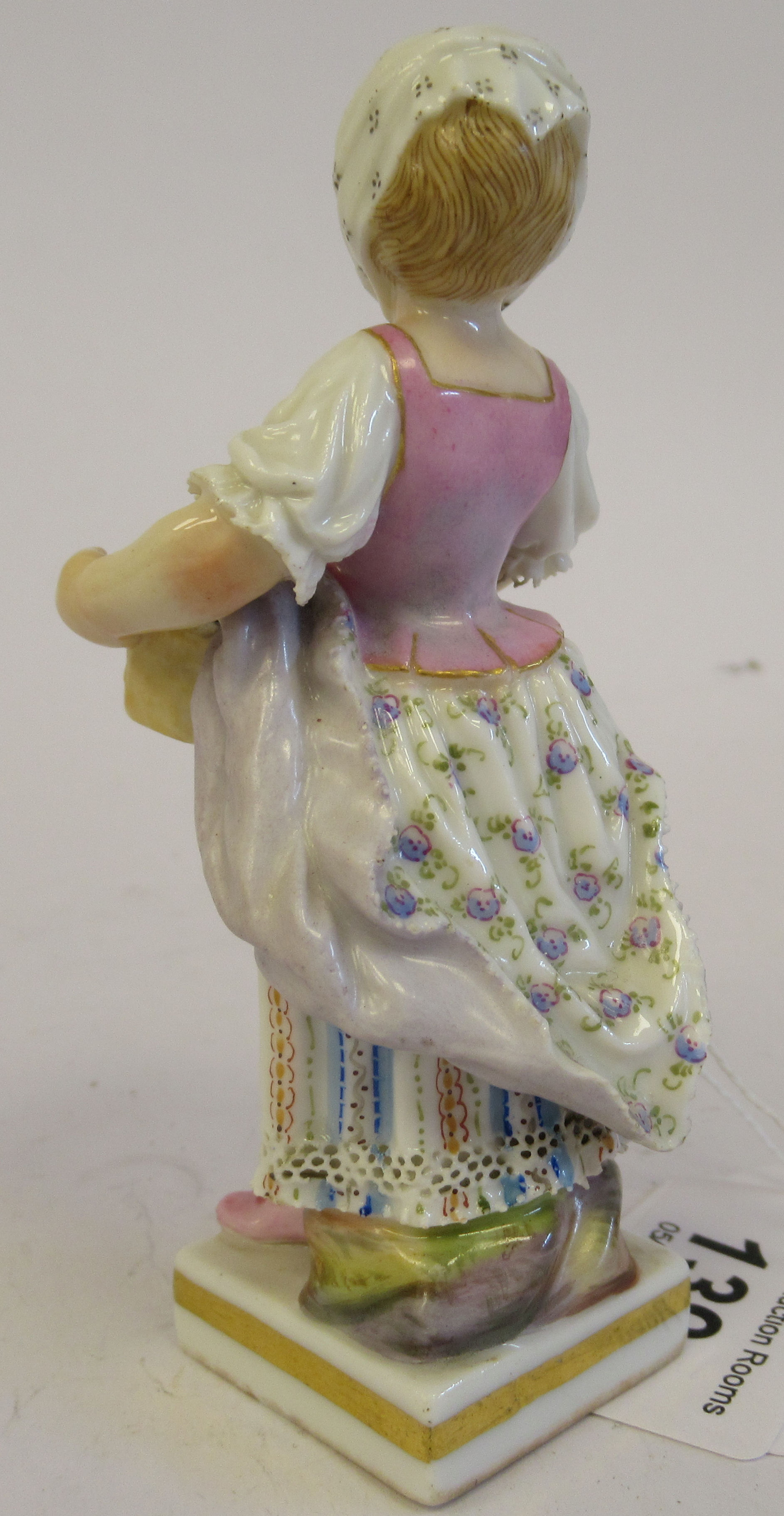 A 19th/20thC Meissen porcelain figure, a girl wearing a floral skirt, carrying a basket of grapes, - Image 3 of 7