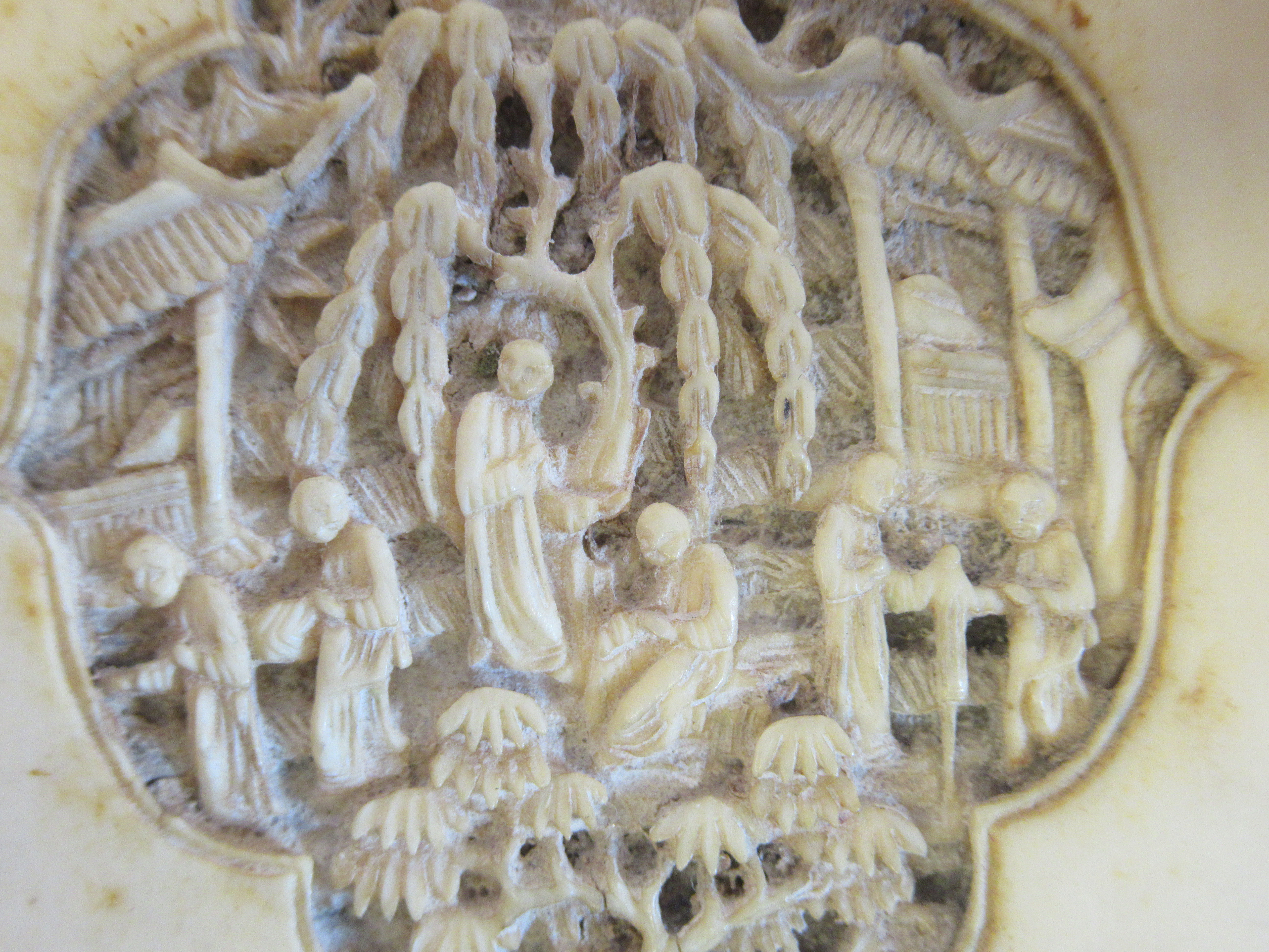 A late 19th/early 20thC Chinese ivory two part card case, carved in vignette panels with figures, in - Image 4 of 5