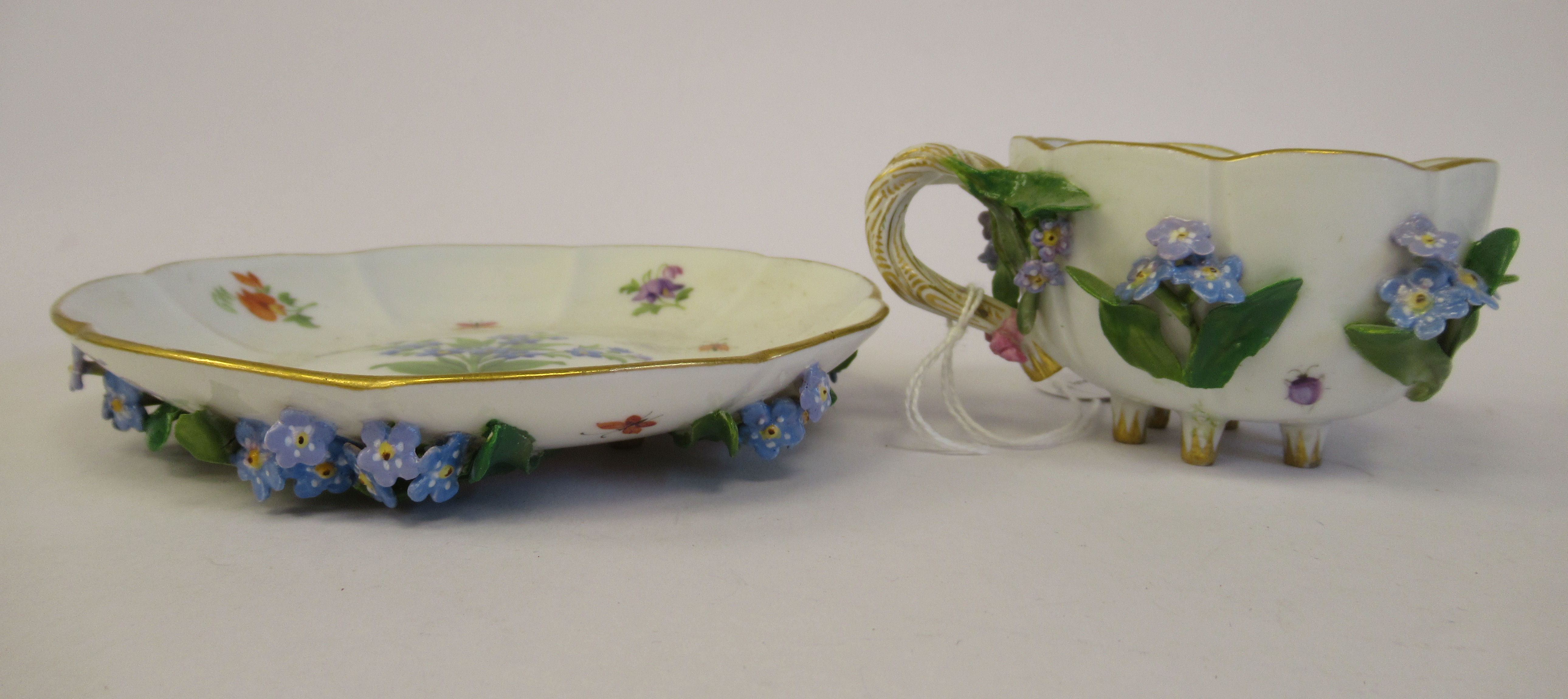 A 19thC Meissen porcelain cup and saucer, having an entwined twig handle, decorated with encrusted - Image 5 of 10