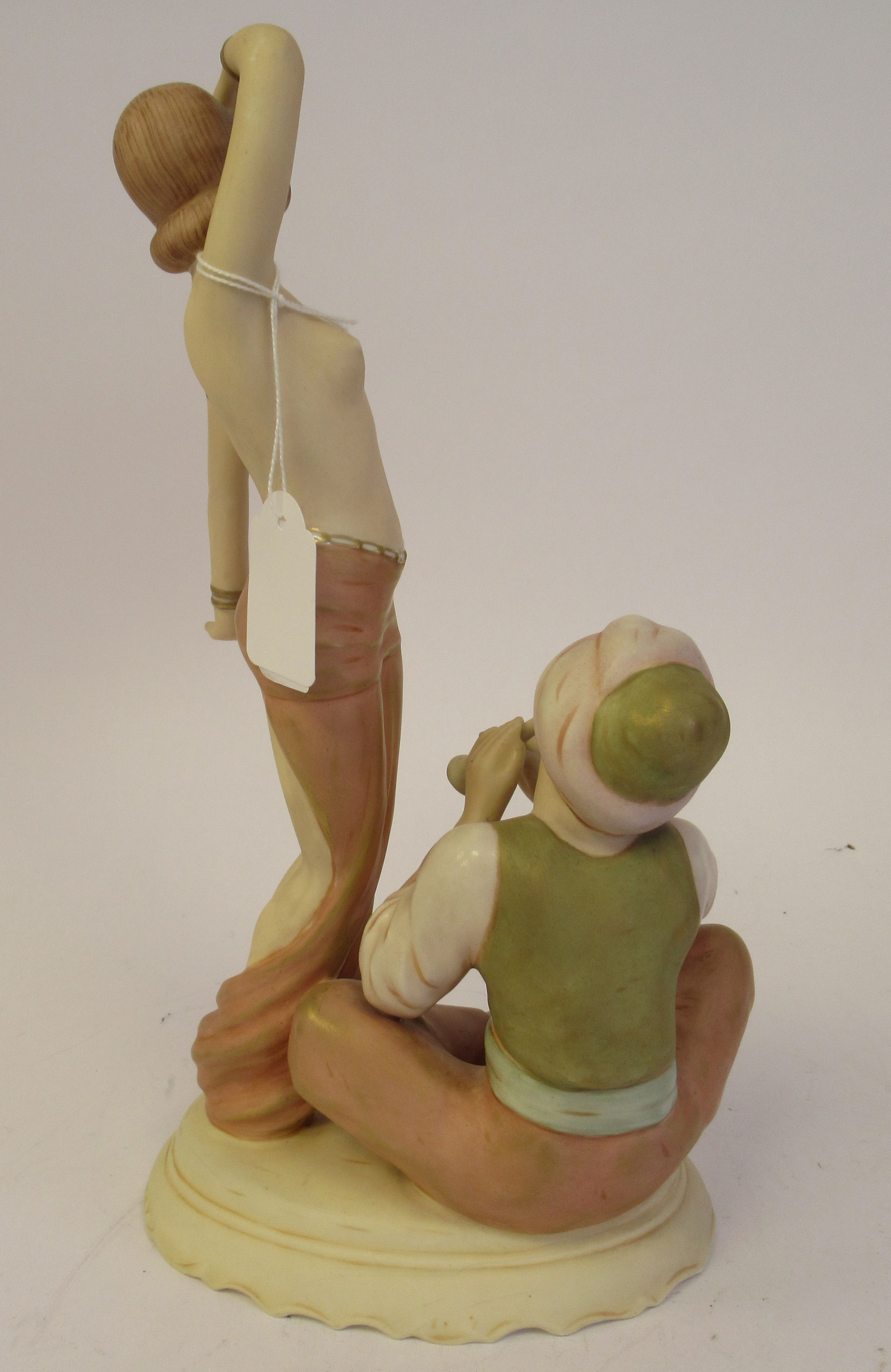 A Royal Dux porcelain group, a dancing maiden, beside a man playing a pipe, on an oval base bears a - Image 3 of 9