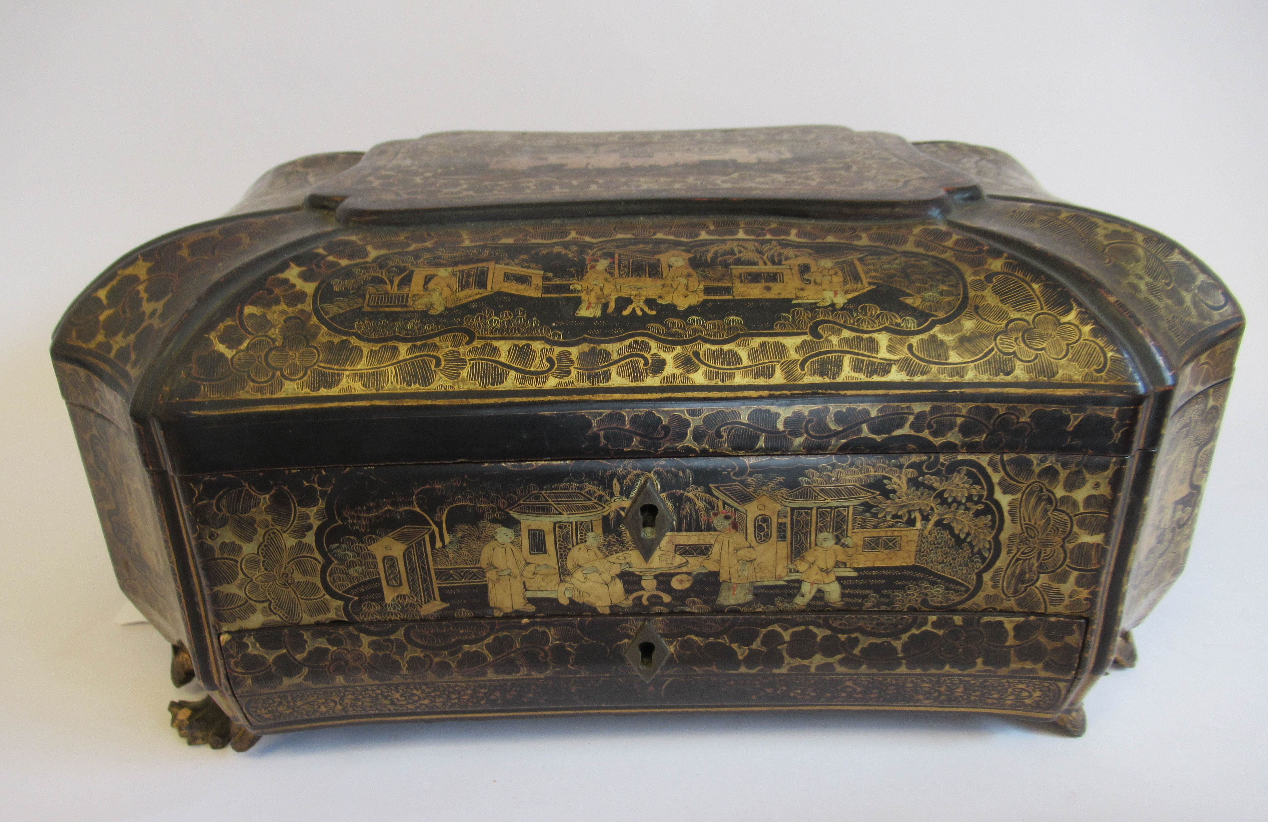 A late 19thC Sino European black lacquered sewing casket of incurved, elongated octagonal form