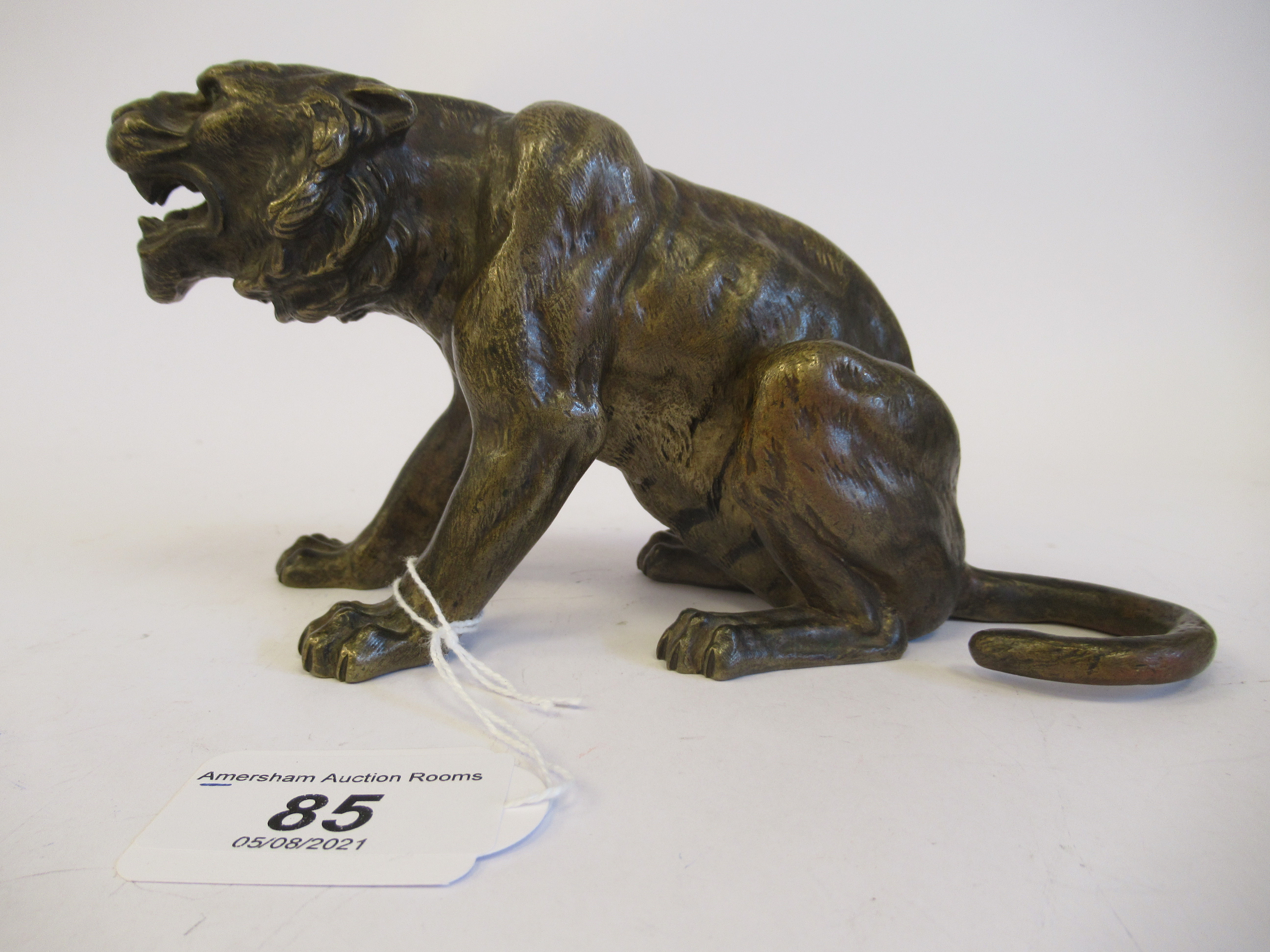 An Austrian cold cast bronze model, a seated, snarling big cat bears traces of paint & an