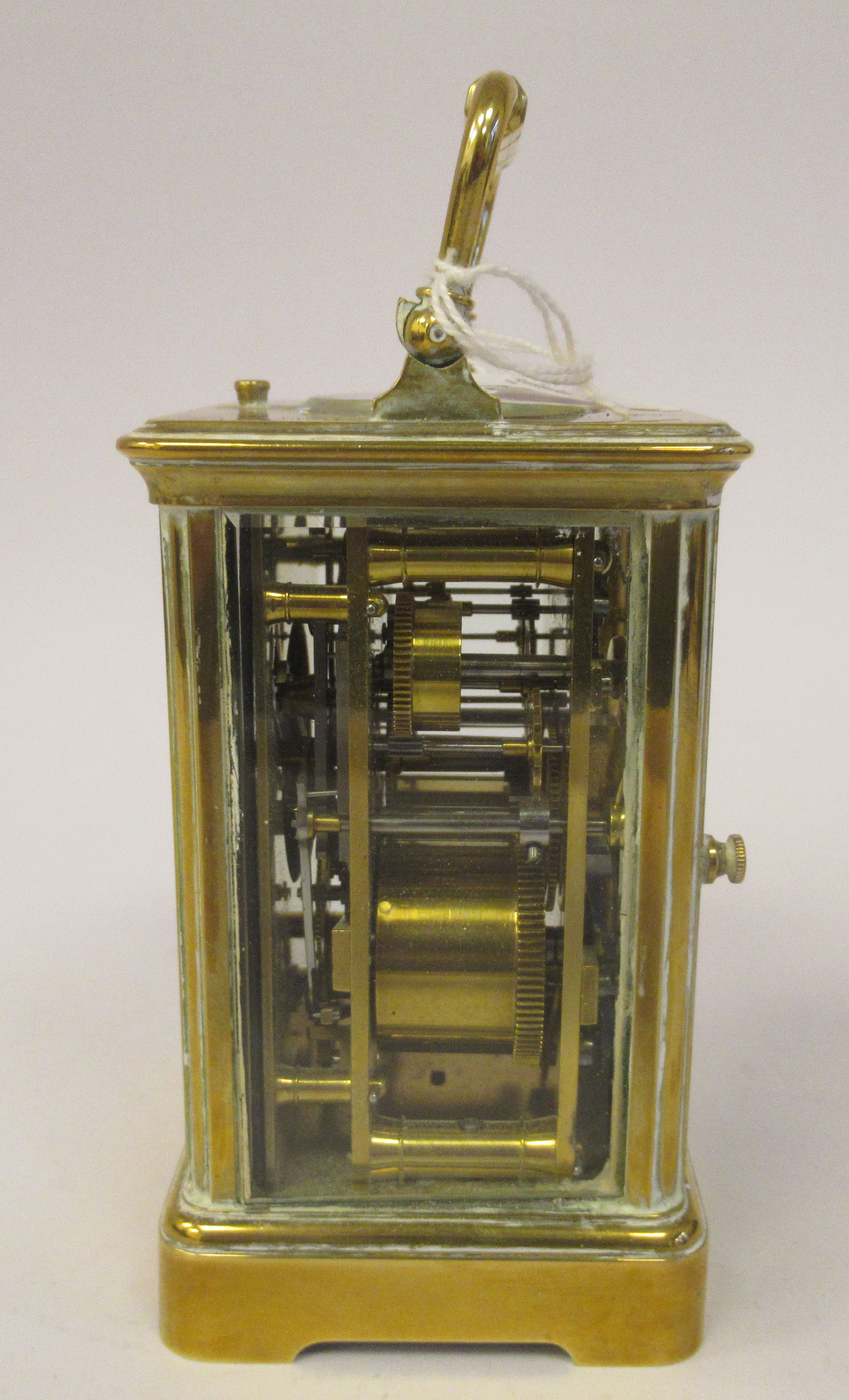 An early 20thC brass cased carriage clock with bevelled glass panels, a folding top handle, on a - Image 3 of 9