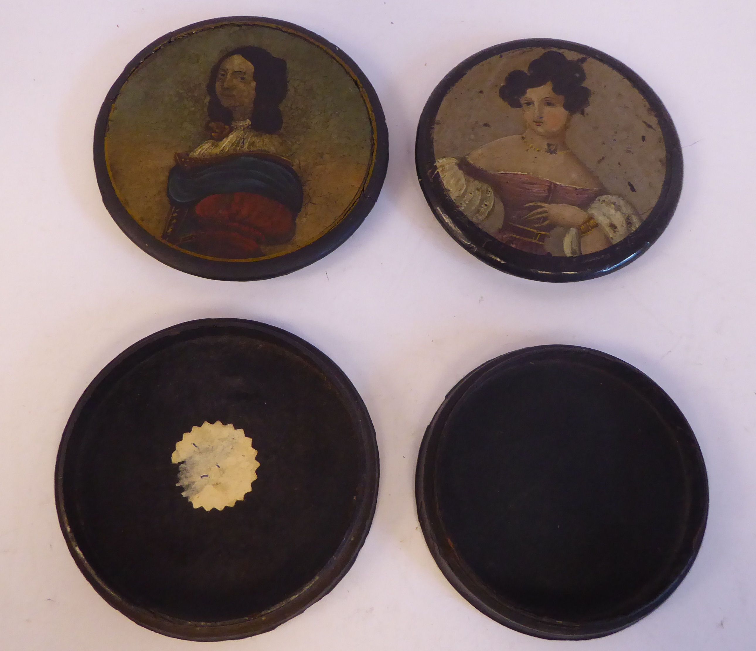 Two similar 18thC black lacquered and overpainted papier mache, shallow snuff boxes, the covers each - Image 2 of 3