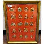 Twenty military regimental cap badges, some copies: to include The West Yorkshire, The Army