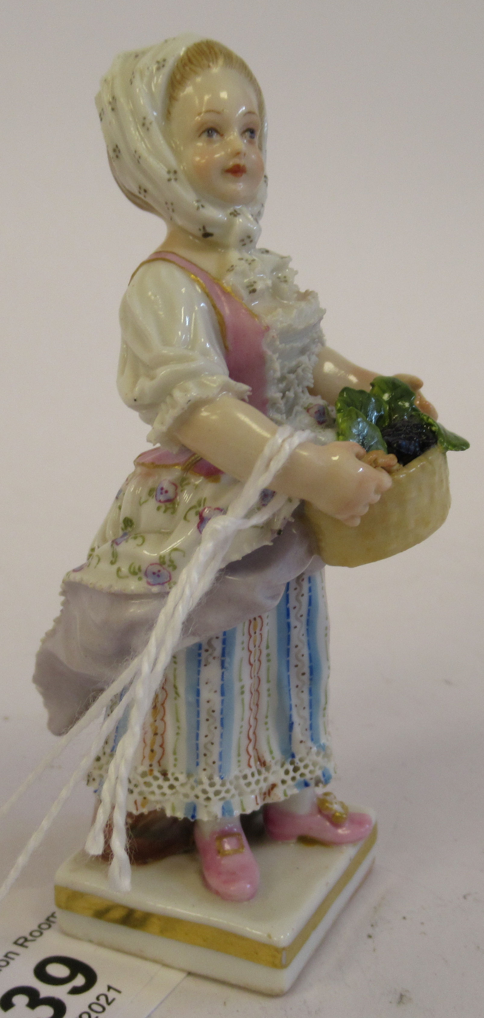 A 19th/20thC Meissen porcelain figure, a girl wearing a floral skirt, carrying a basket of grapes, - Image 2 of 7