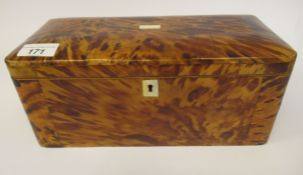 A 19thC tortoiseshell clad tea casket with straight sides, a hinged lid and a part fitted