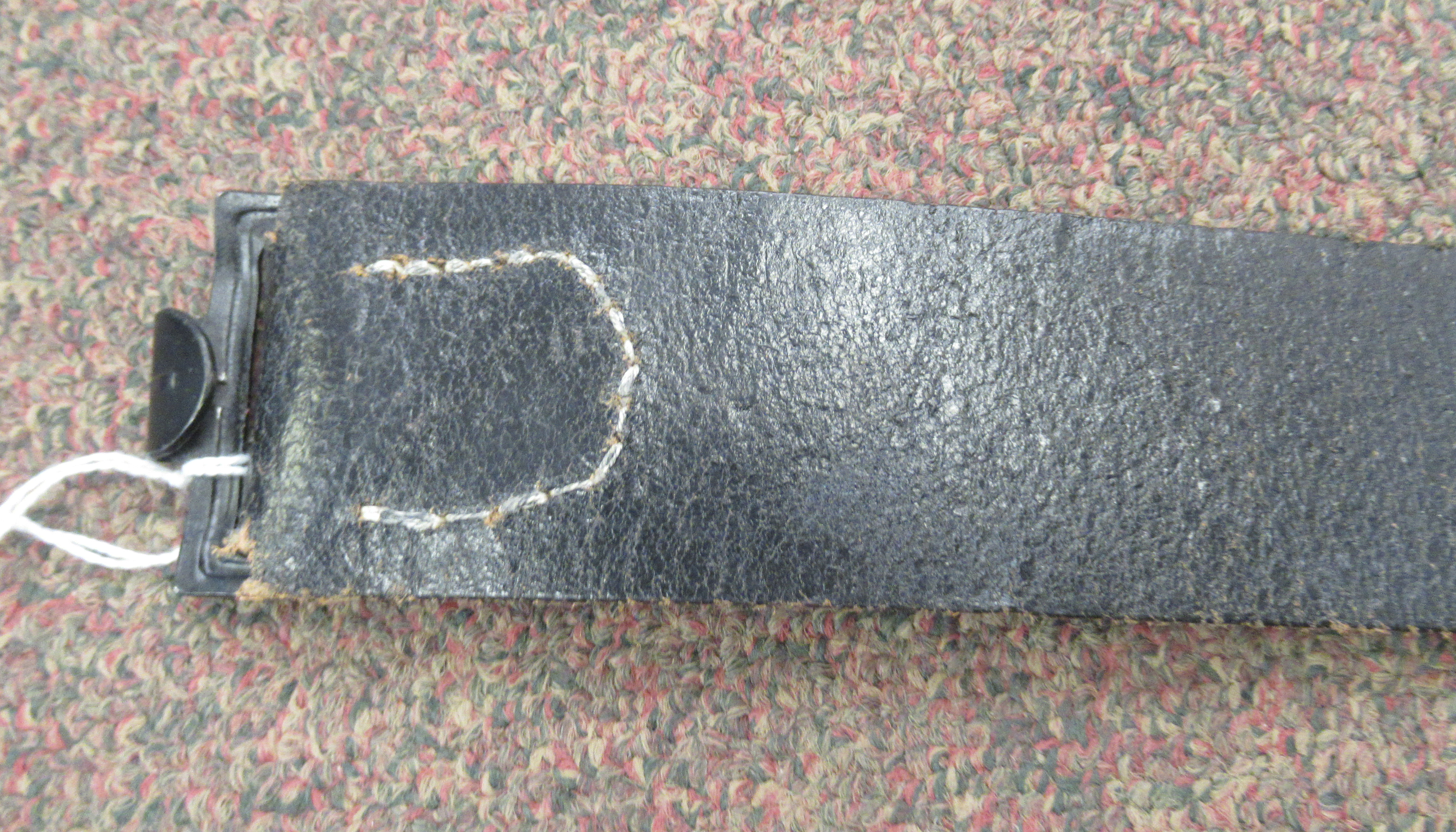 A Third Reich Luftwaffe black hide belt with an impressed weathered spreadeagle emblem, on the white - Image 3 of 5