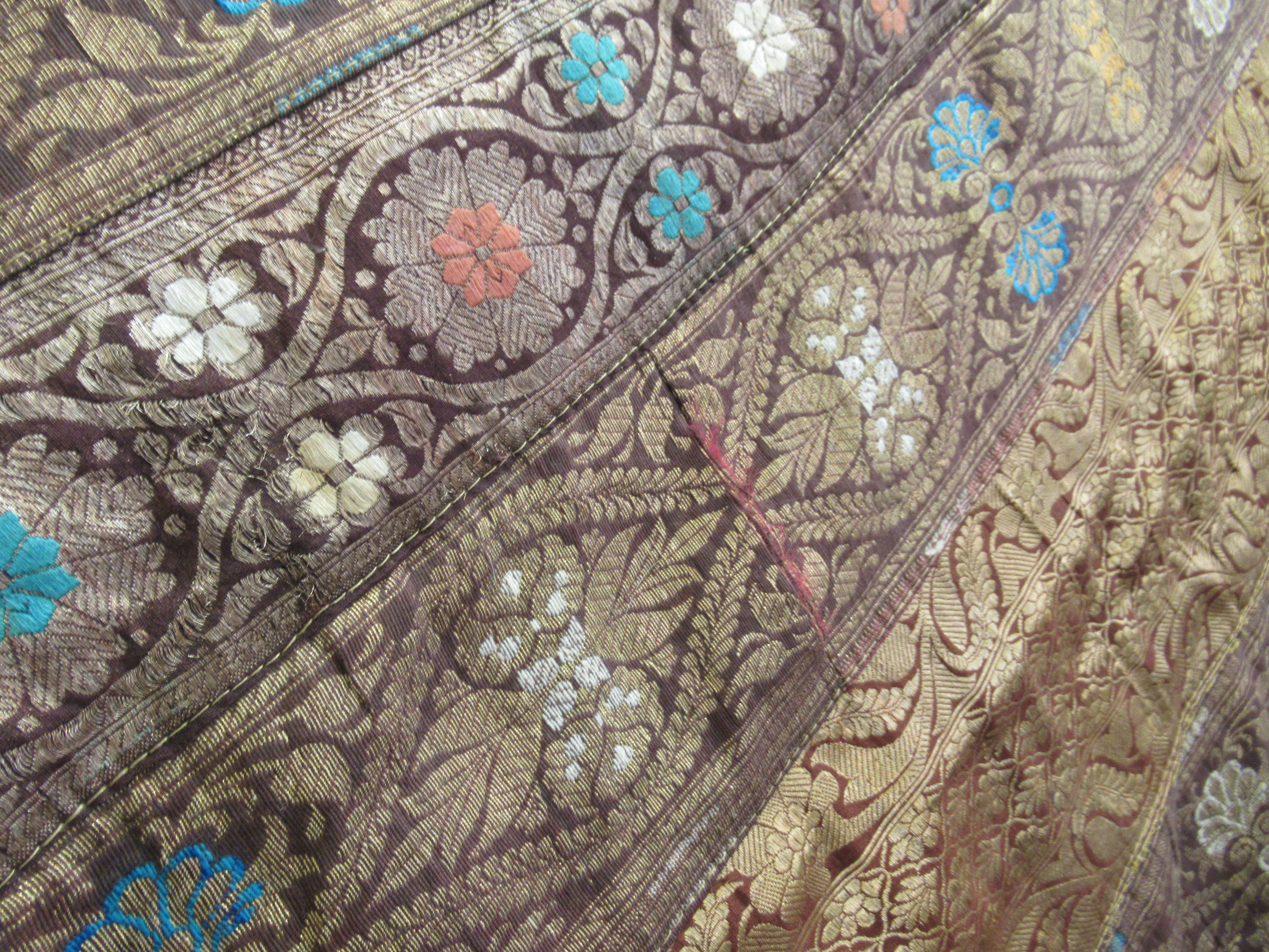 An Indian part silk bed throw, profusely decorated with repeating floral designs with a black fabric - Image 6 of 7