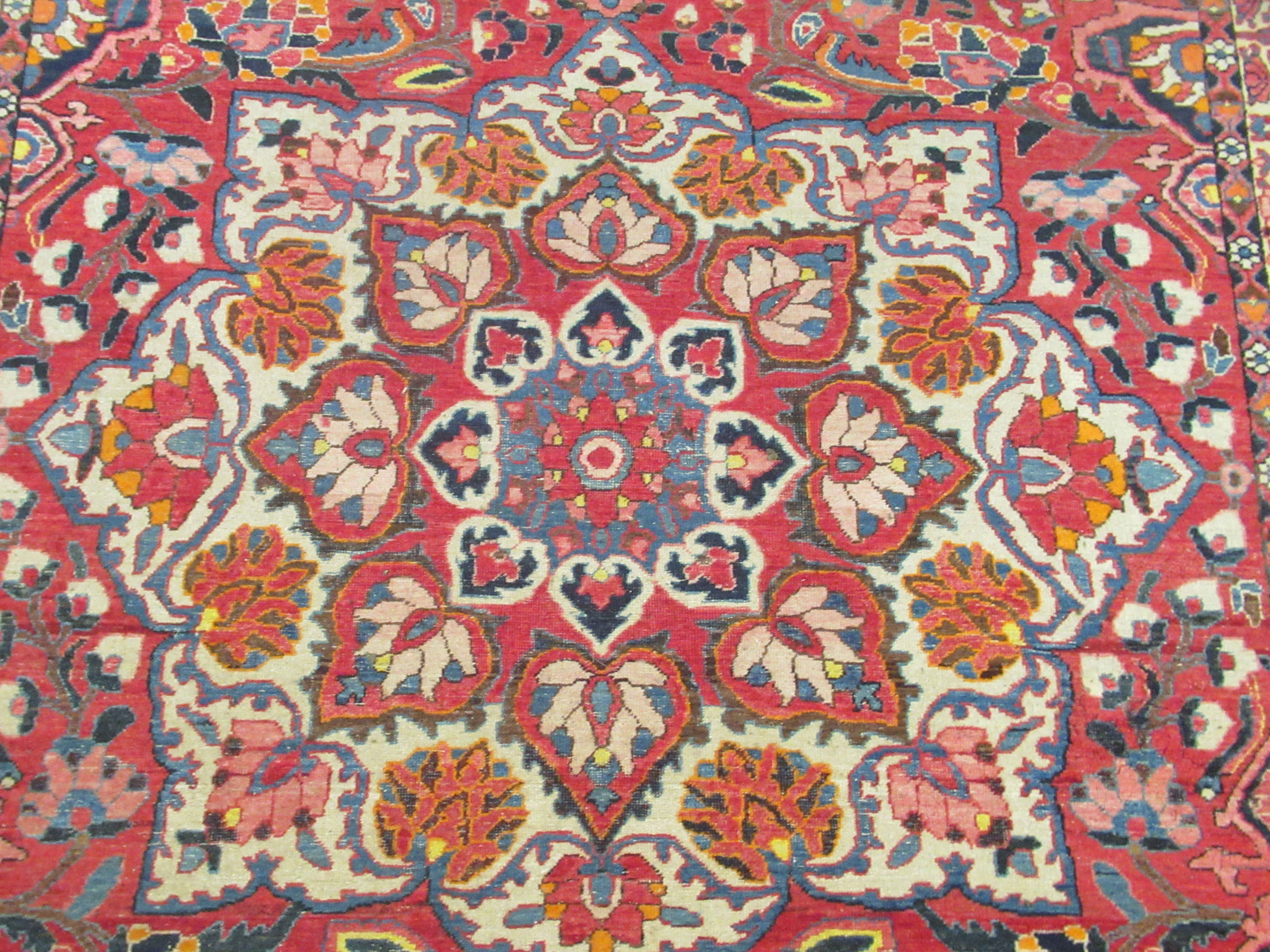 A Persian carpet, profusely decorated with flora and other designs, on a multi-coloured and red - Image 2 of 5