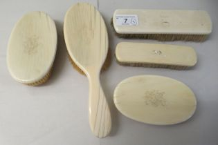 An gentleman's Edwardian set of five ivory back hairbrushes